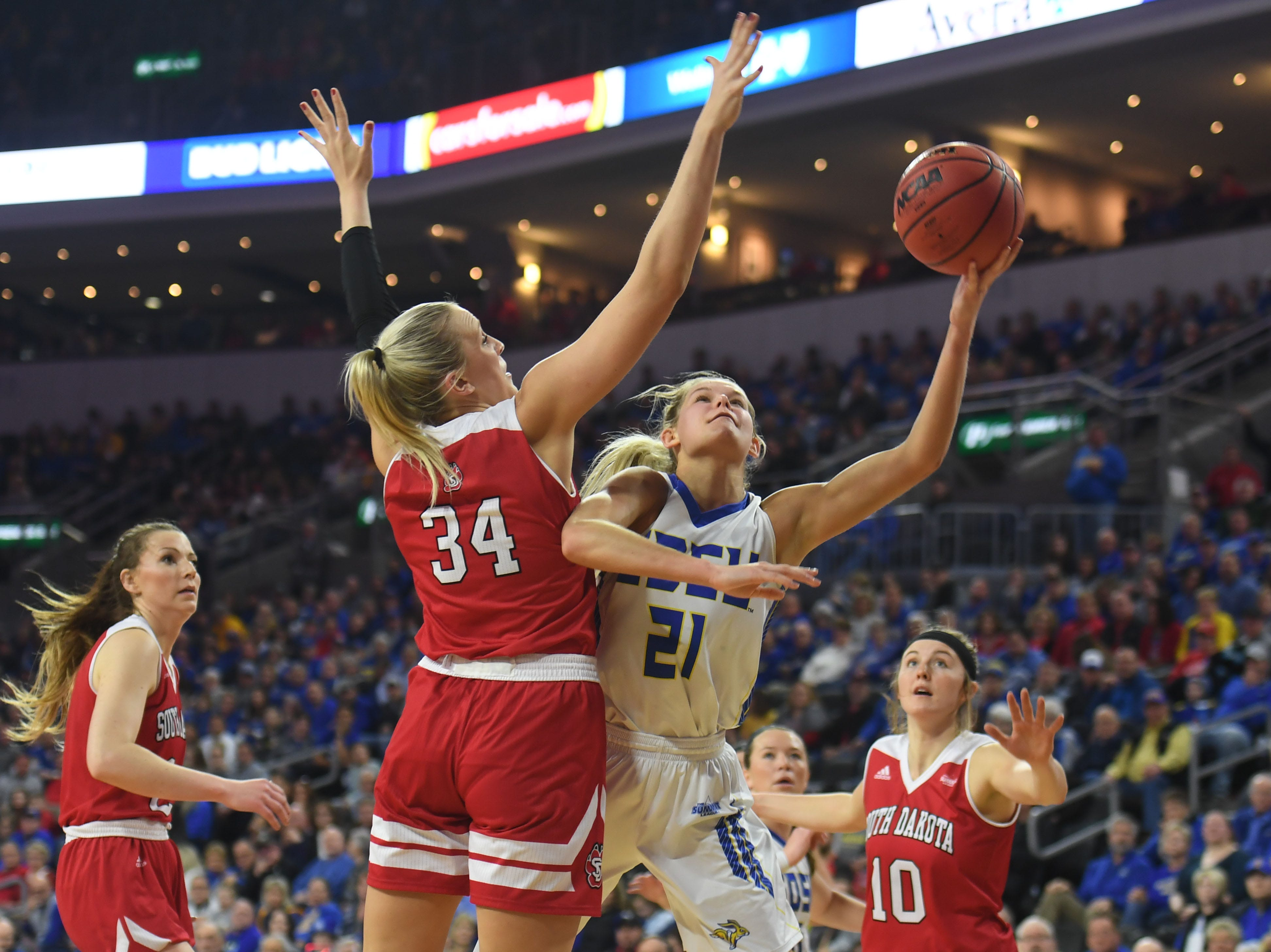 SDSU's Tylee Irwin goes against USD's Hannah Sjerven under the net Tuesday, March 12, in the Summit League women's championship at the Denny Sanford Premier Center in Sioux Falls.