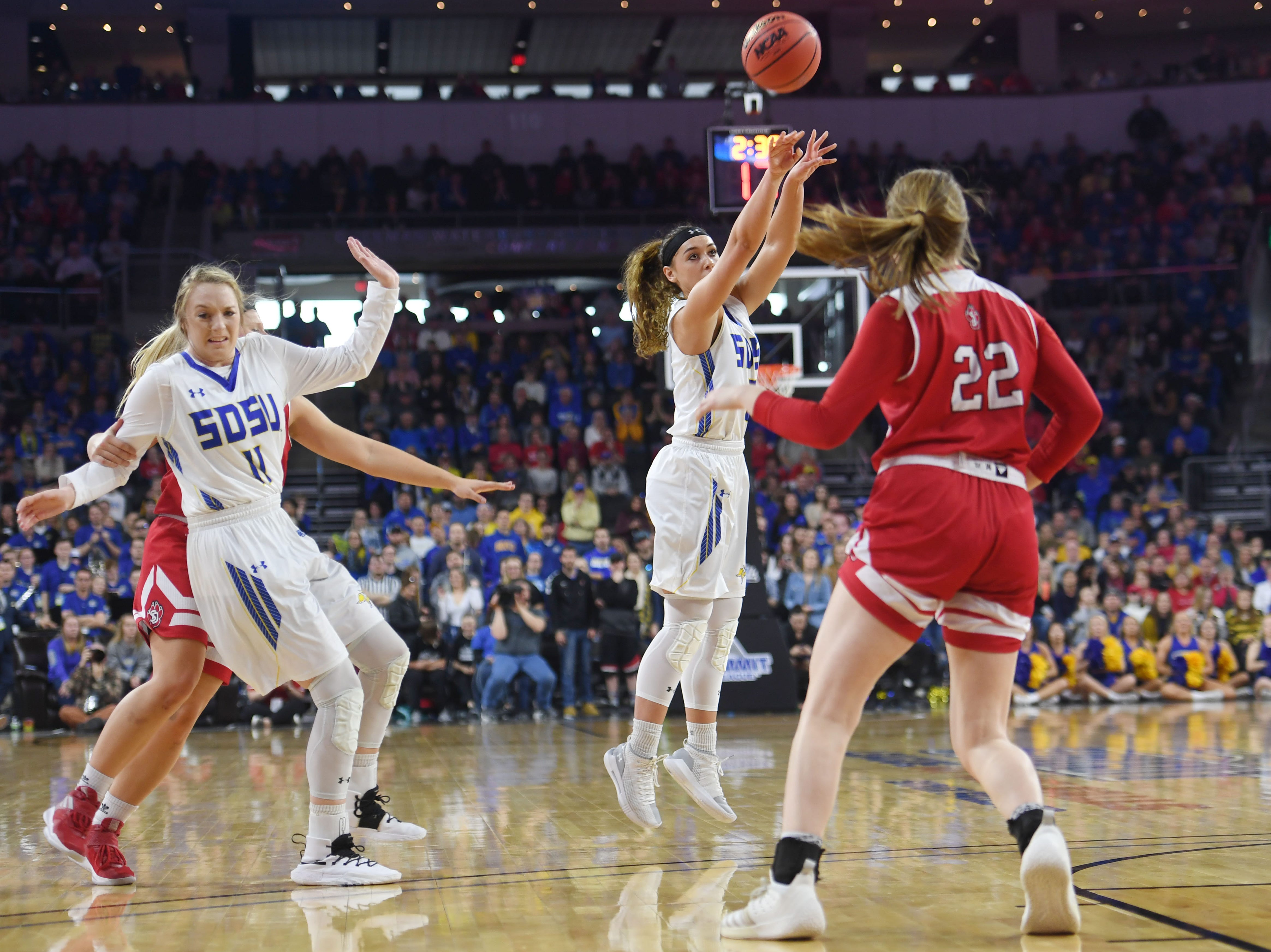 SDSU's Rylie Cascio Jensen goes against USD defense during the game Tuesday, March 12, in the Summit League women's championship at the Denny Sanford Premier Center in Sioux Falls.