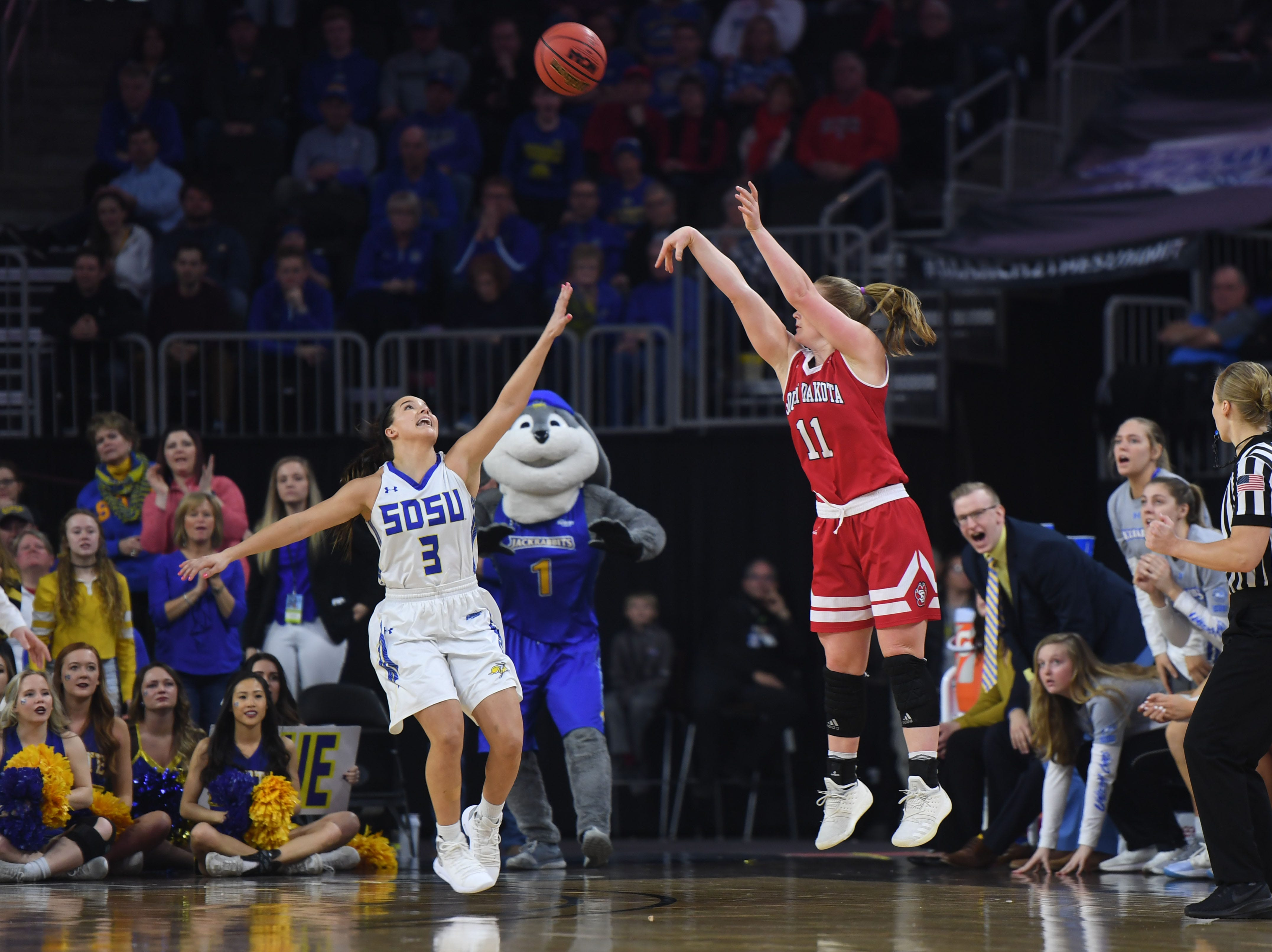 USD's Monica Arens takes a shot against SDSU's Lindsey Theuninck during the game Tuesday, March 12, in the Summit League women's championship at the Denny Sanford Premier Center in Sioux Falls.