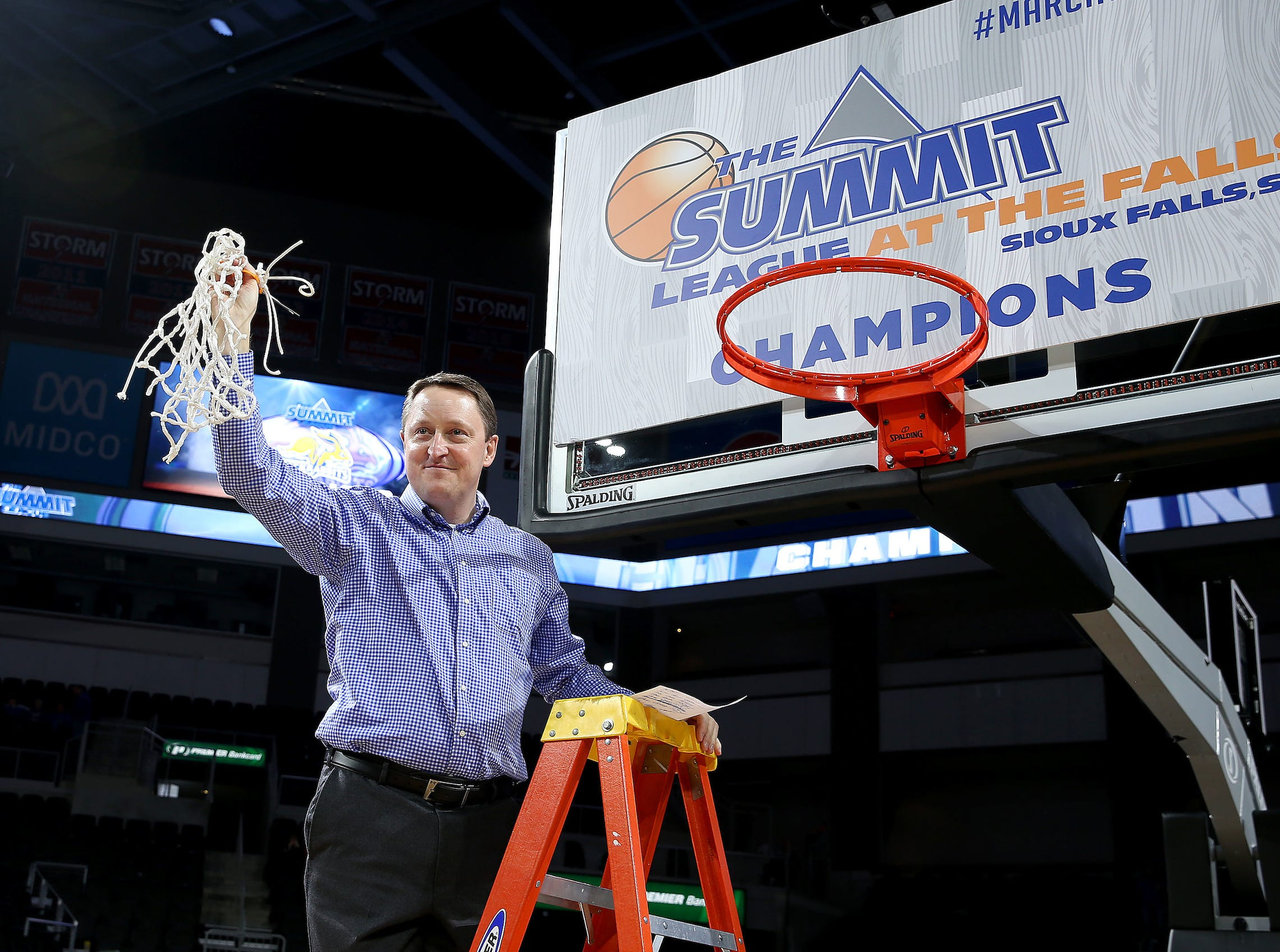 SIOUX FALLS, SD - MARCH 11: South Dakota State head coach Aaron Johnston grasps the net at the 2019 Summit League Basketball Tournament at the Denny Sanford Premier Center in Sioux Falls. (Photo by Dave Eggen/Inertia)