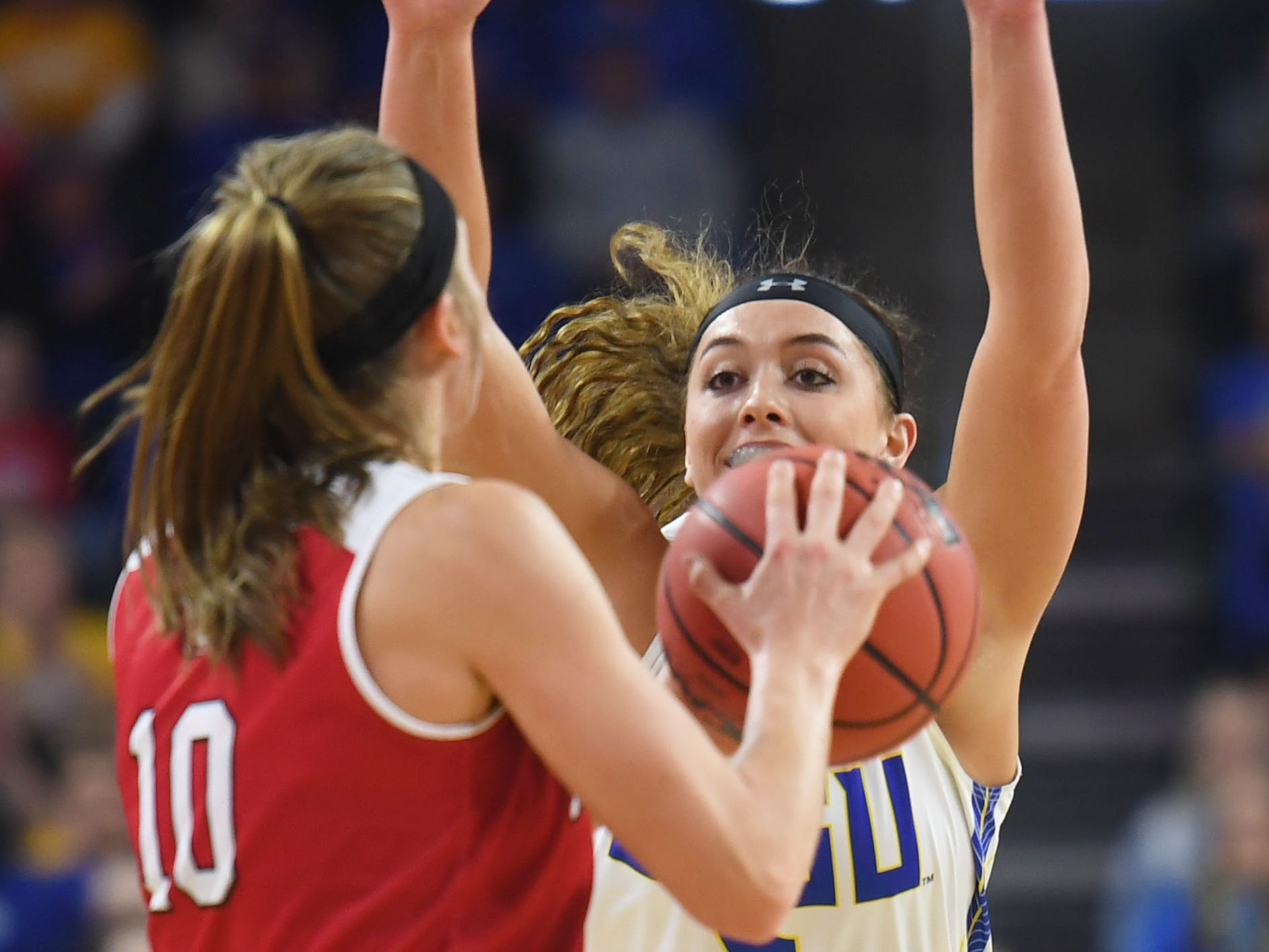 SDSU's Rylie Cascio Jensen goes against USD's Allison Arens during the game Tuesday, March 12, in the Summit League women's championship at the Denny Sanford Premier Center in Sioux Falls.