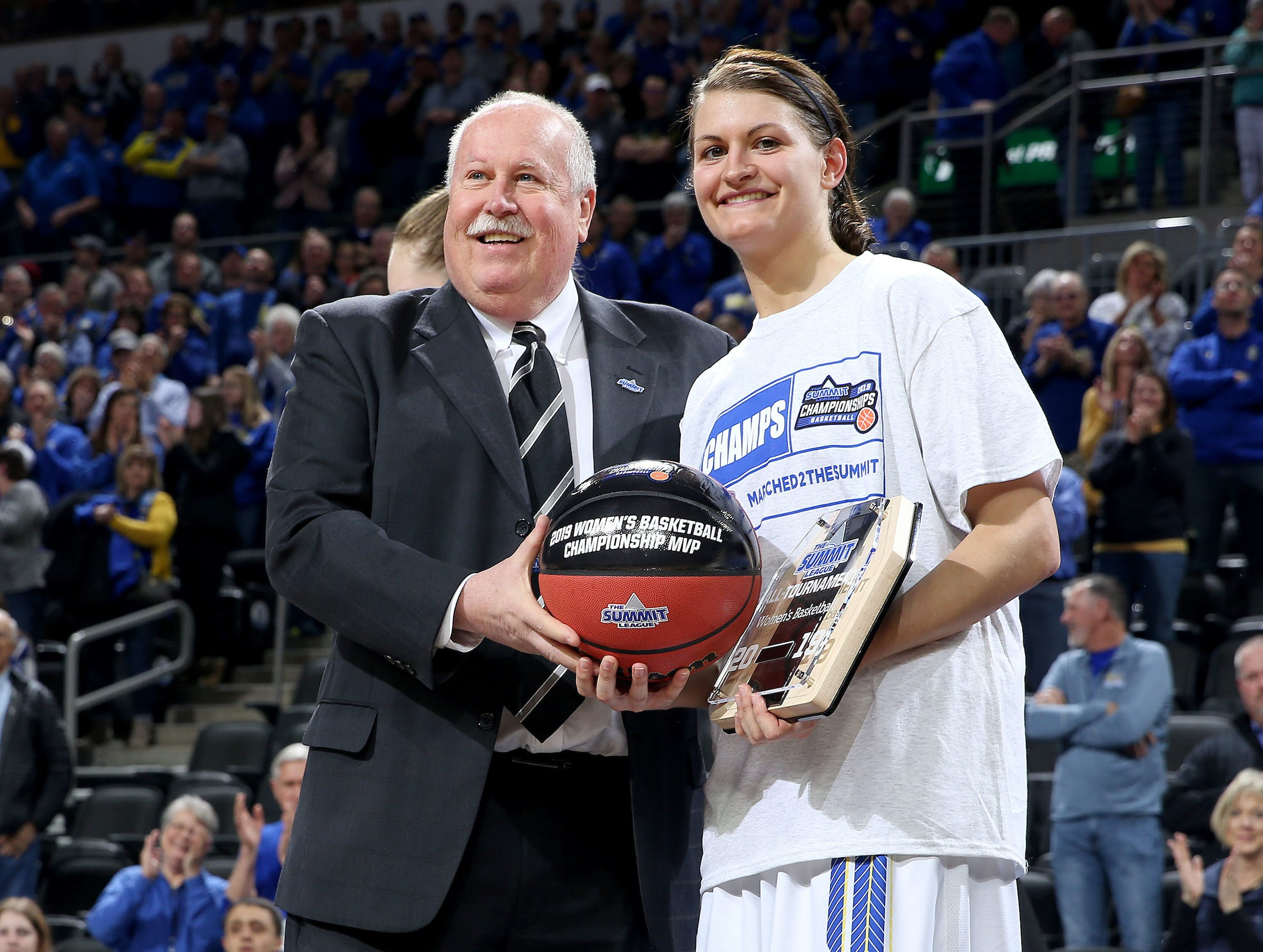 SIOUX FALLS, SD - MARCH 11: Summit League Commissioner Tom Douple poses with Summit League Player of the Year Macy Miller at the 2019 Summit League Basketball Tournament at the Denny Sanford Premier Center in Sioux Falls. (Photo by Dave Eggen/Inertia)