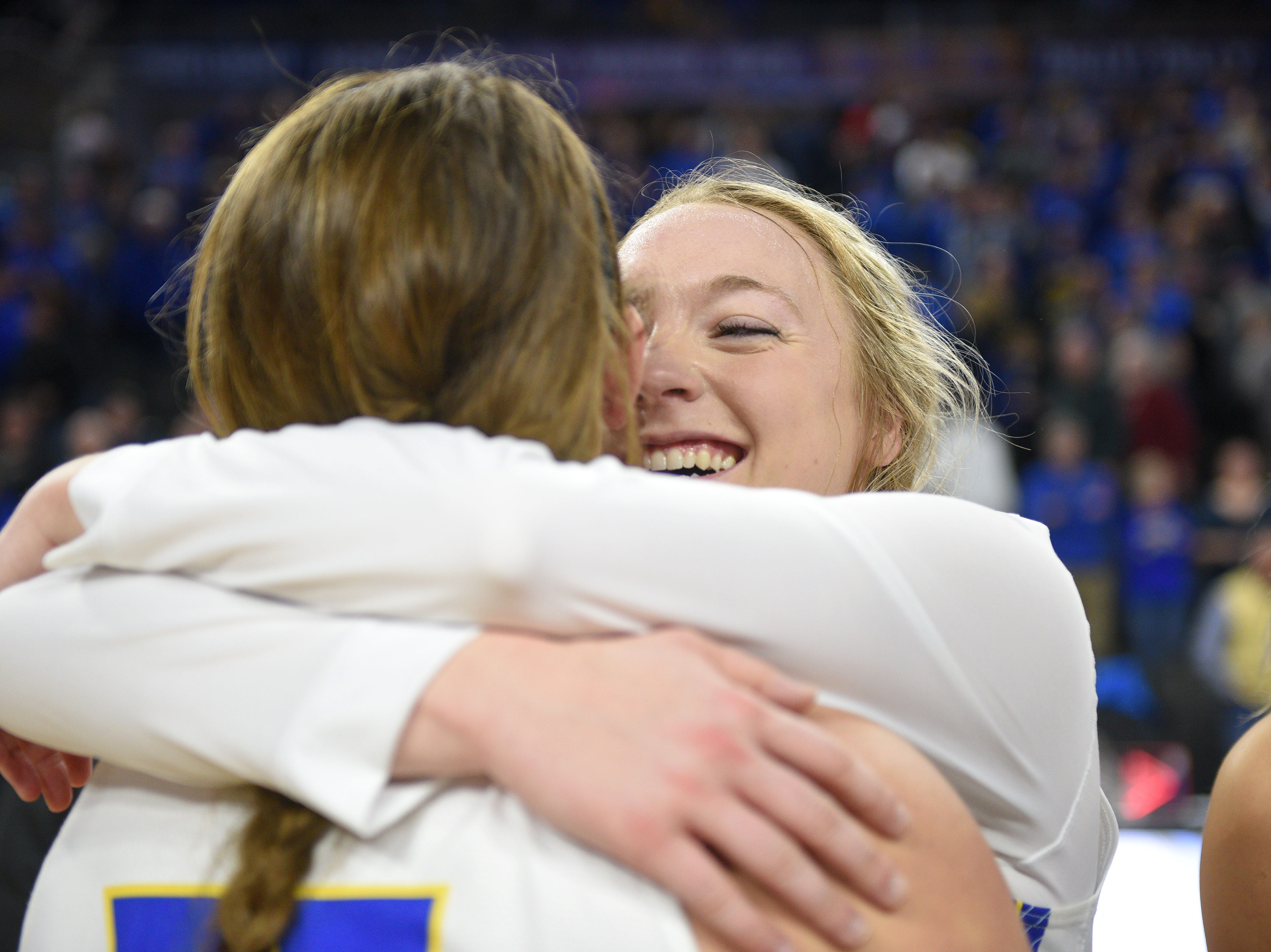 SDSU's Madison Guebert hugs her teammates after their win against USD Tuesday, March 12, in the Summit League women's championship at the Denny Sanford Premier Center in Sioux Falls.