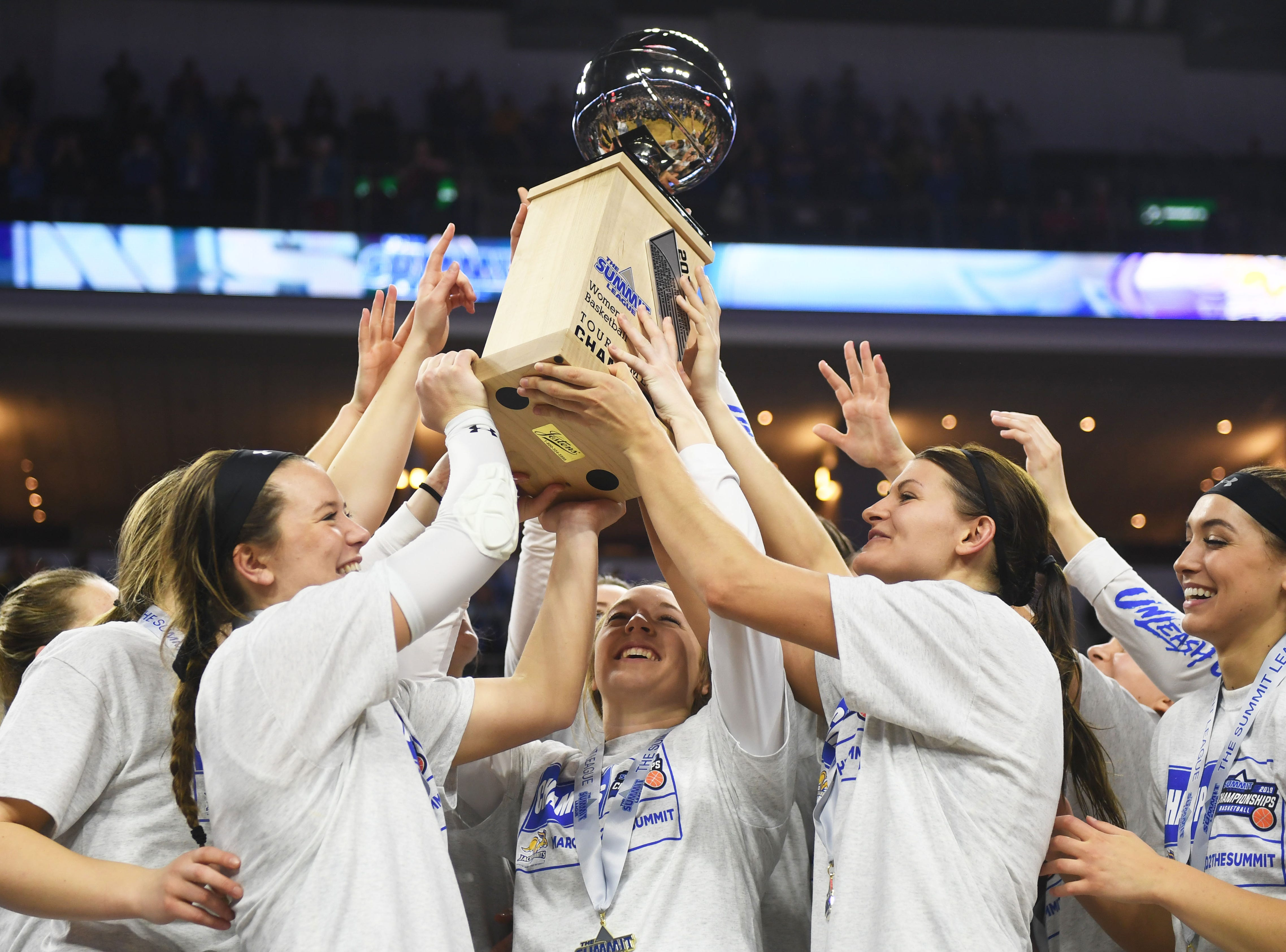 SDSU celebrates their win against USD Tuesday, March 12, in the Summit League women's championship at the Denny Sanford Premier Center in Sioux Falls. SDSU won 83-71 against USD.