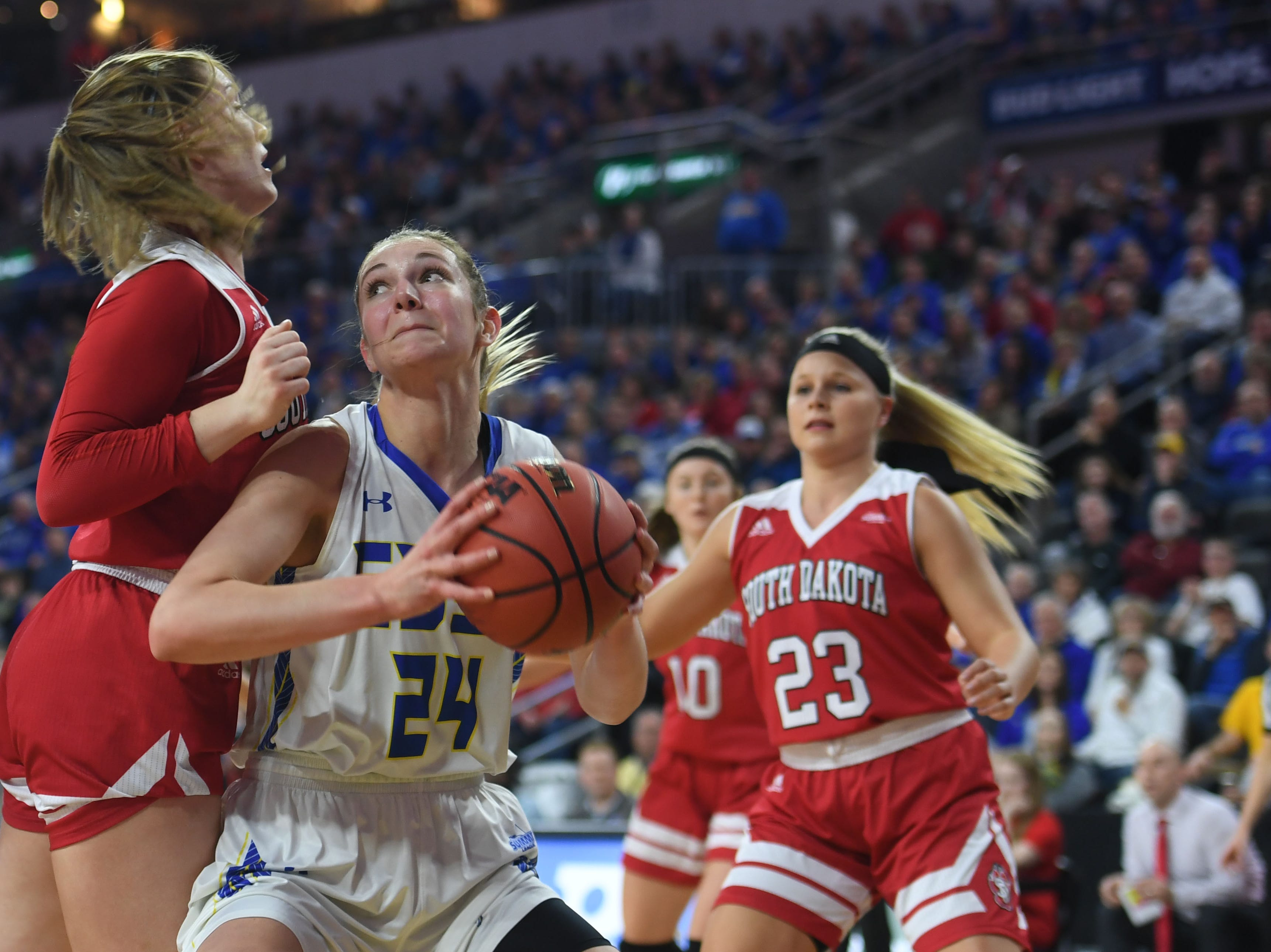 SDSU's Tagyn Larson goes against USD defense during the game Tuesday, March 12, in the Summit League women's championship at the Denny Sanford Premier Center in Sioux Falls.