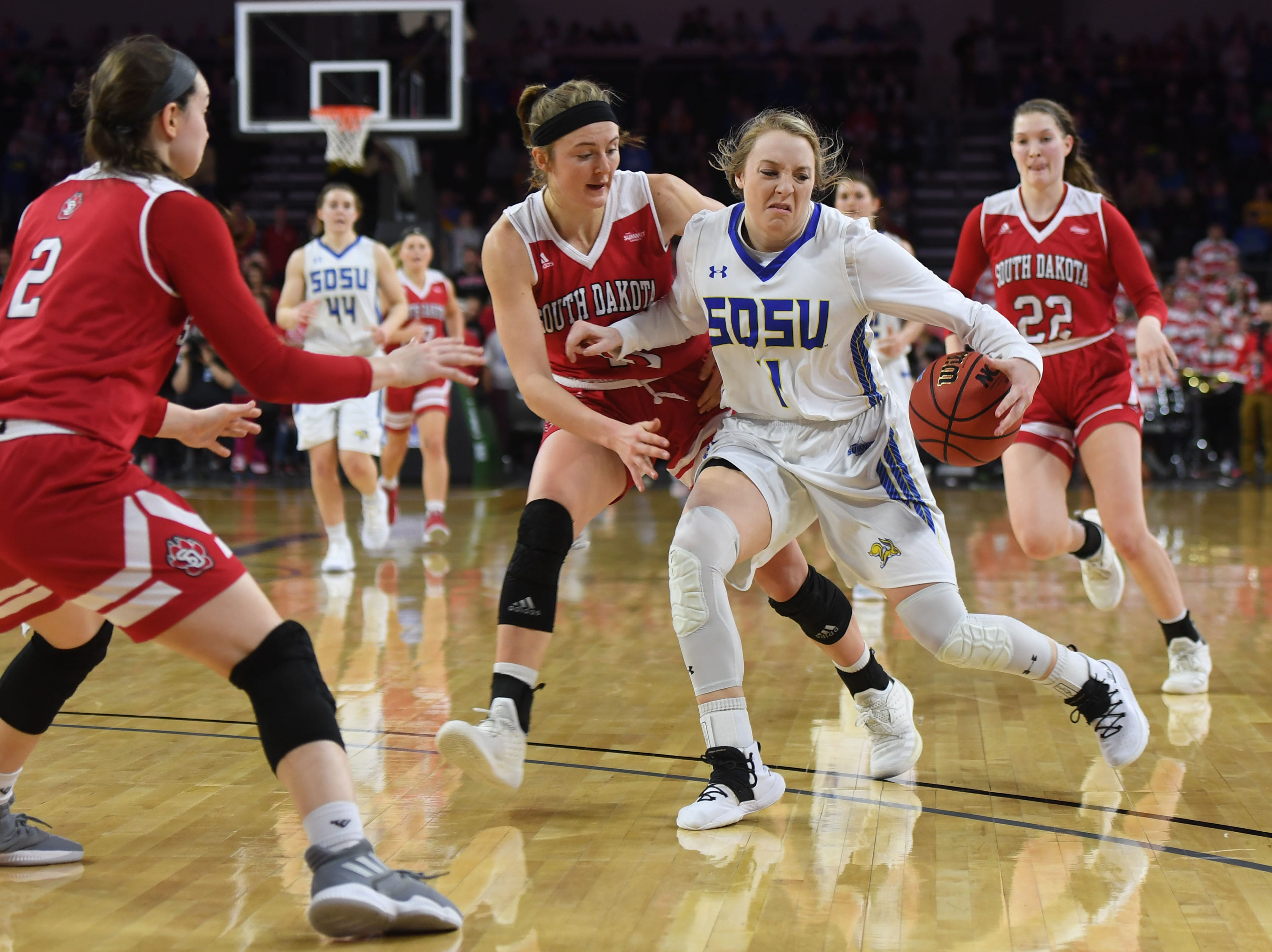 SDSU's Madison Guebert goes against USD defense during the game Tuesday, March 12, in the Summit League women's championship at the Denny Sanford Premier Center in Sioux Falls.