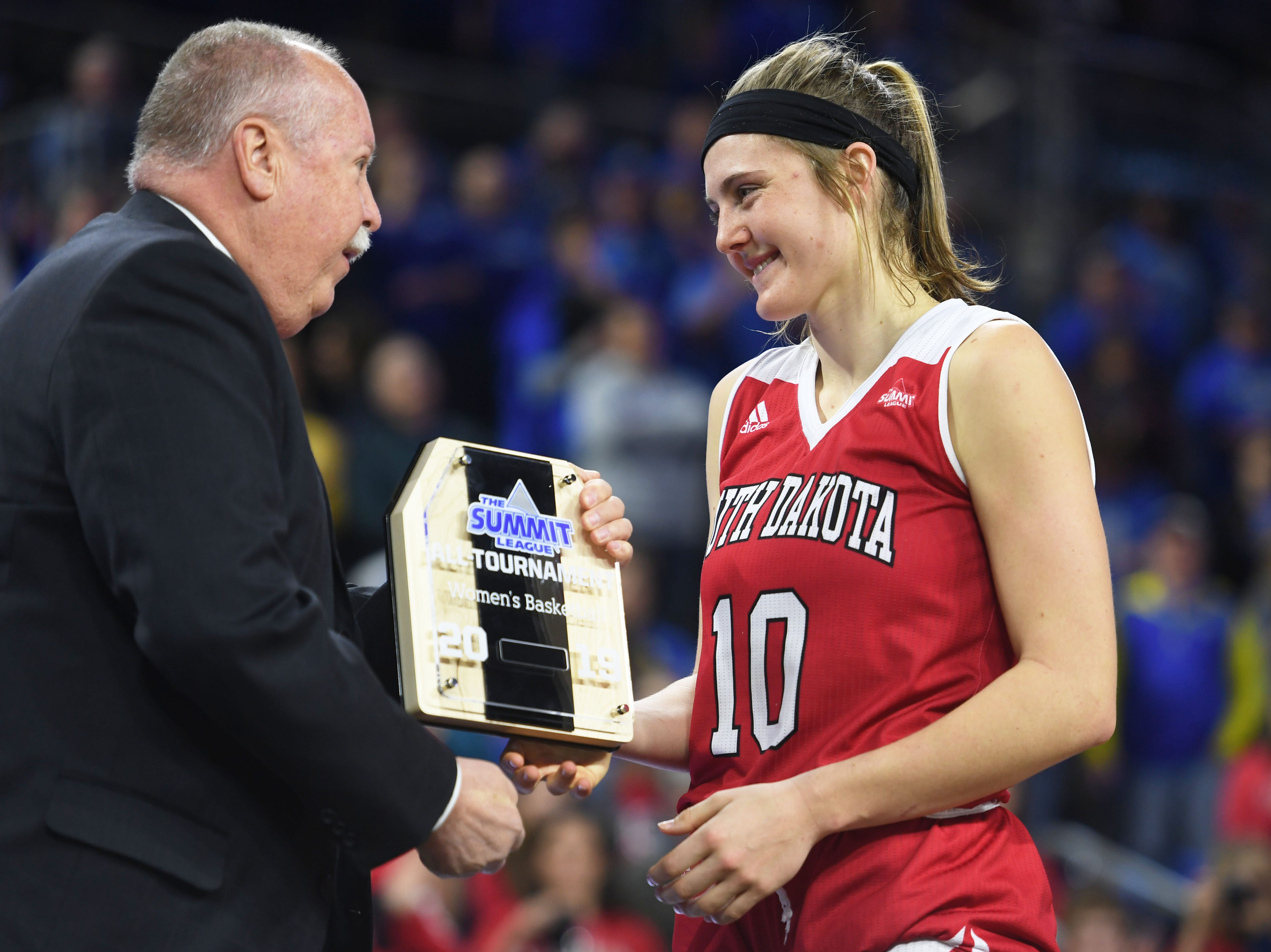 USD's Allison Arens is recognized after the game against SDSU Tuesday, March 12, in the Summit League women's championship at the Denny Sanford Premier Center in Sioux Falls.