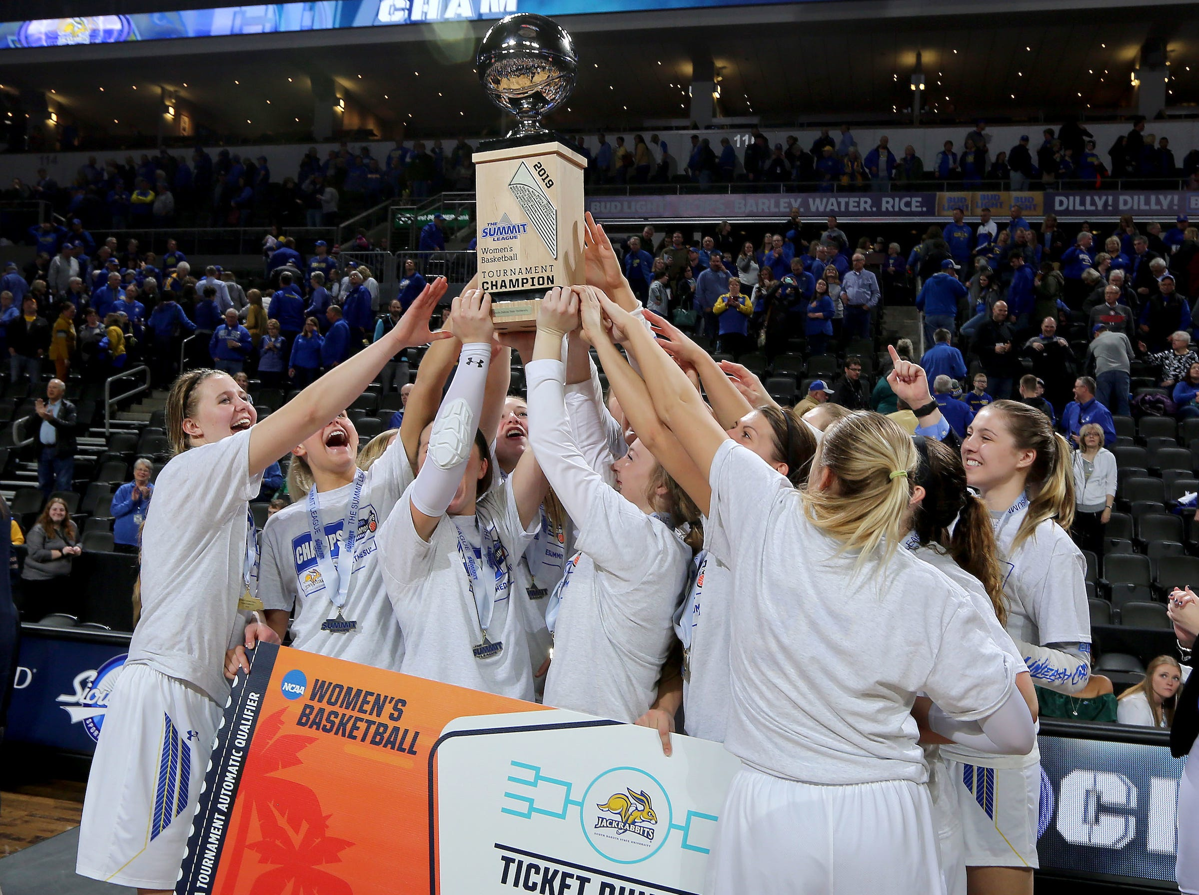 SIOUX FALLS, SD - MARCH 11: The South Dakota State women hoist the 2019 Summit League Championship trophy at the Denny Sanford Premier Center in Sioux Falls. (Photo by Dave Eggen/Inertia)