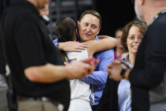 SDSU's head coach Aaron Johnston hugs Macy Miller after their win against USD Tuesday, March 12, in the Summit League women's championship at the Denny Sanford Premier Center in Sioux Falls.