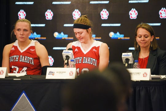 USD's Allison Arens, center, begins to tear up during the press conference after their lose to SDSU Tuesday, March 12, in the Summit League women's championship at the Denny Sanford Premier Center in Sioux Falls.