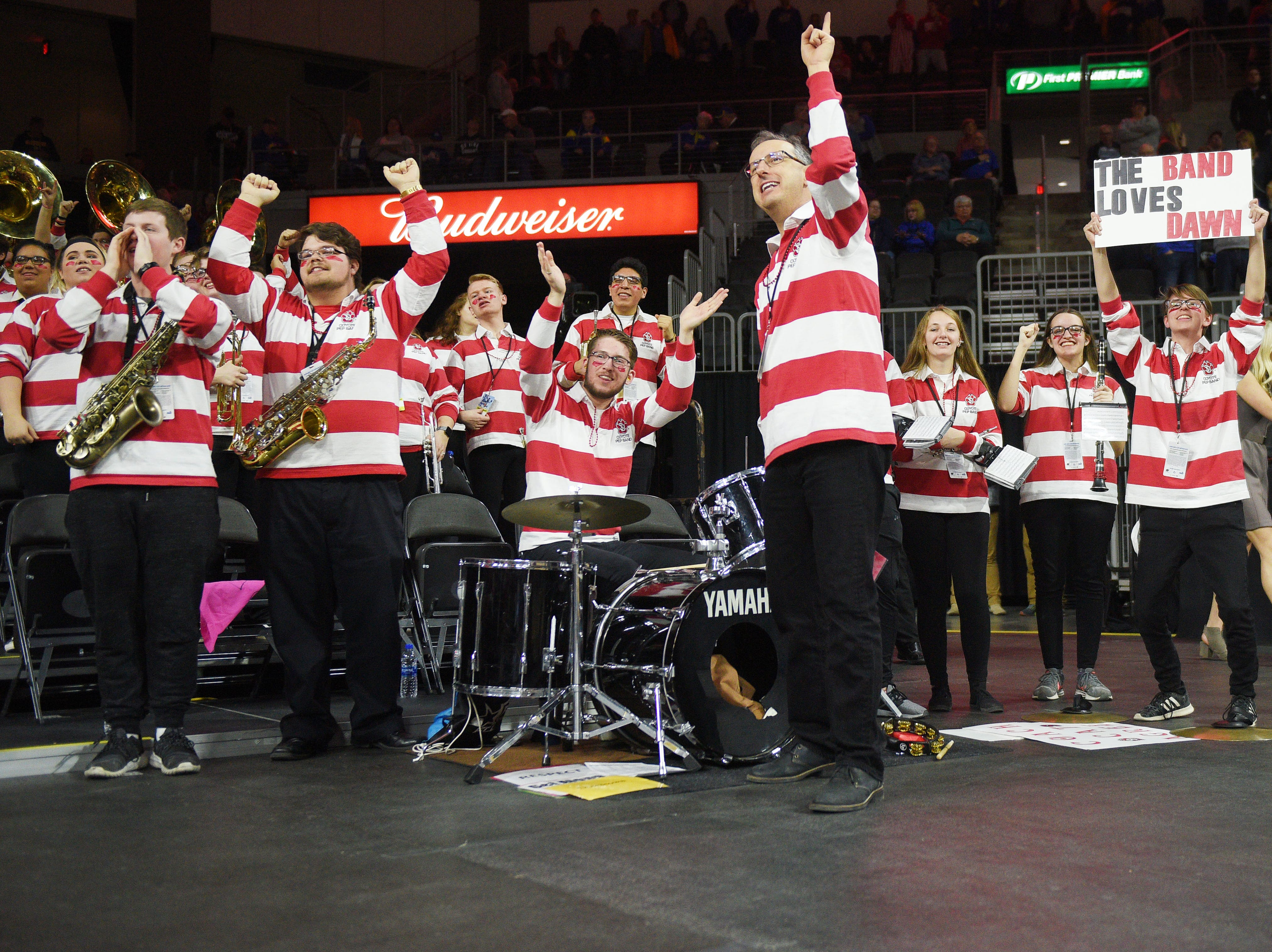 "USD's band cheers, ""the band loves Dawn"" before the game against SDSU Tuesday, March 12, in the Summit League women's championship at the Denny Sanford Premier Center in Sioux Falls."