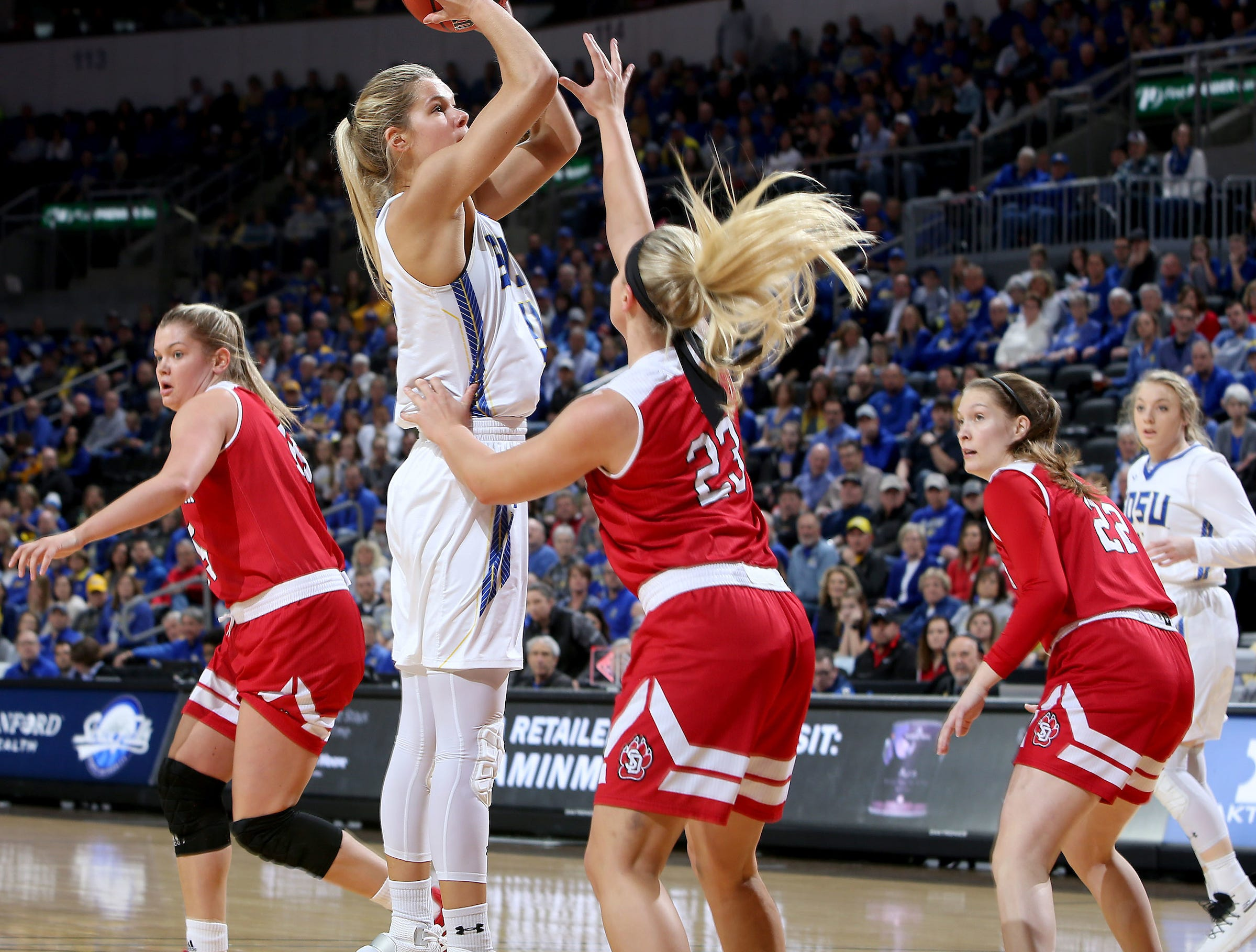 SIOUX FALLS, SD - MARCH 11: Tylee Irwin #21 from South Dakota State shoots over Madison McKeever#23 from South Dakota at the 2019 Summit League Basketball Tournament at the Denny Sanford Premier Center in Sioux Falls. (Photo by Dave Eggen/Inertia)