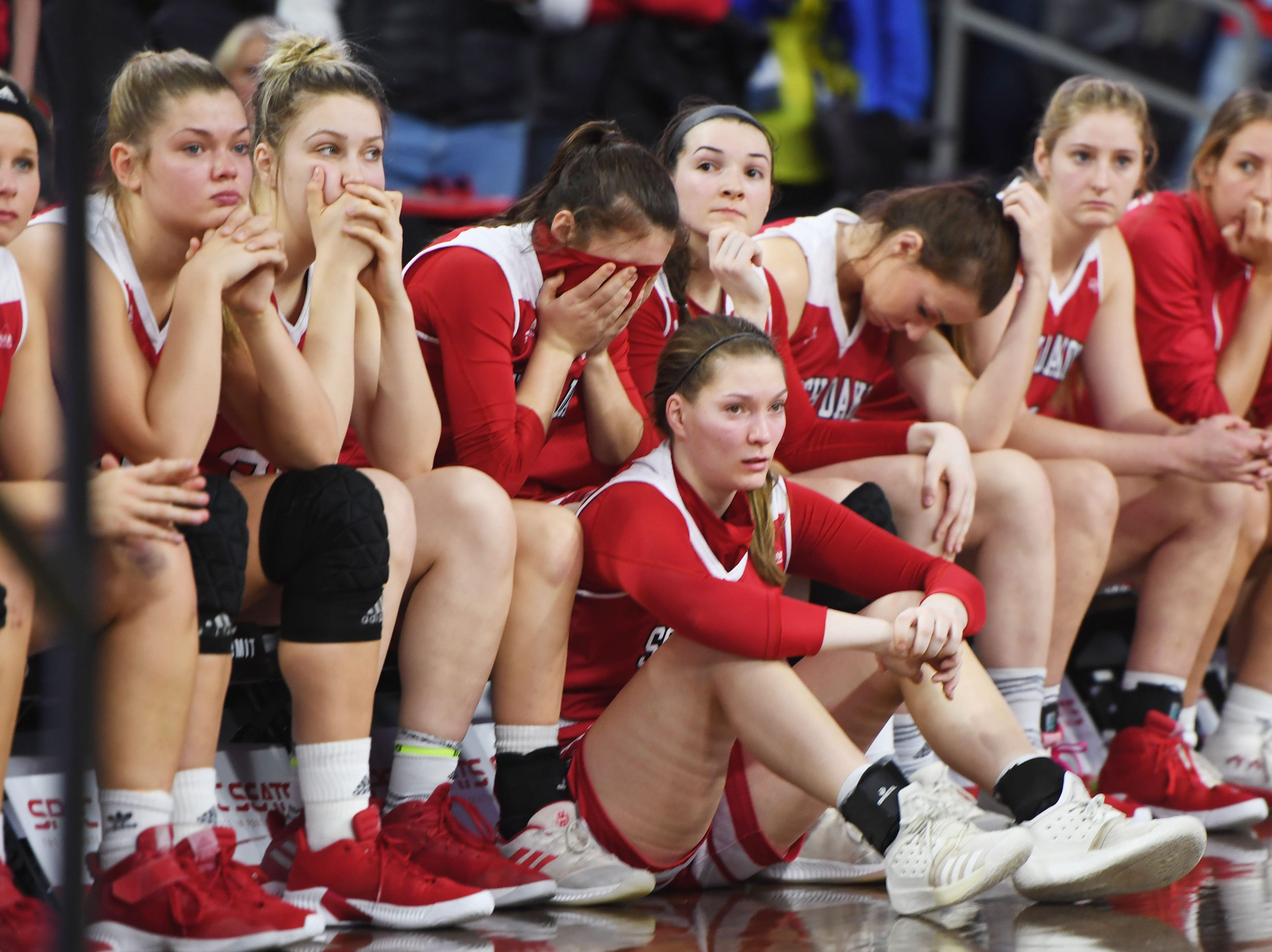 USD goes to their bench after the lose against SDSU Tuesday, March 12, in the Summit League women's championship at the Denny Sanford Premier Center in Sioux Falls.