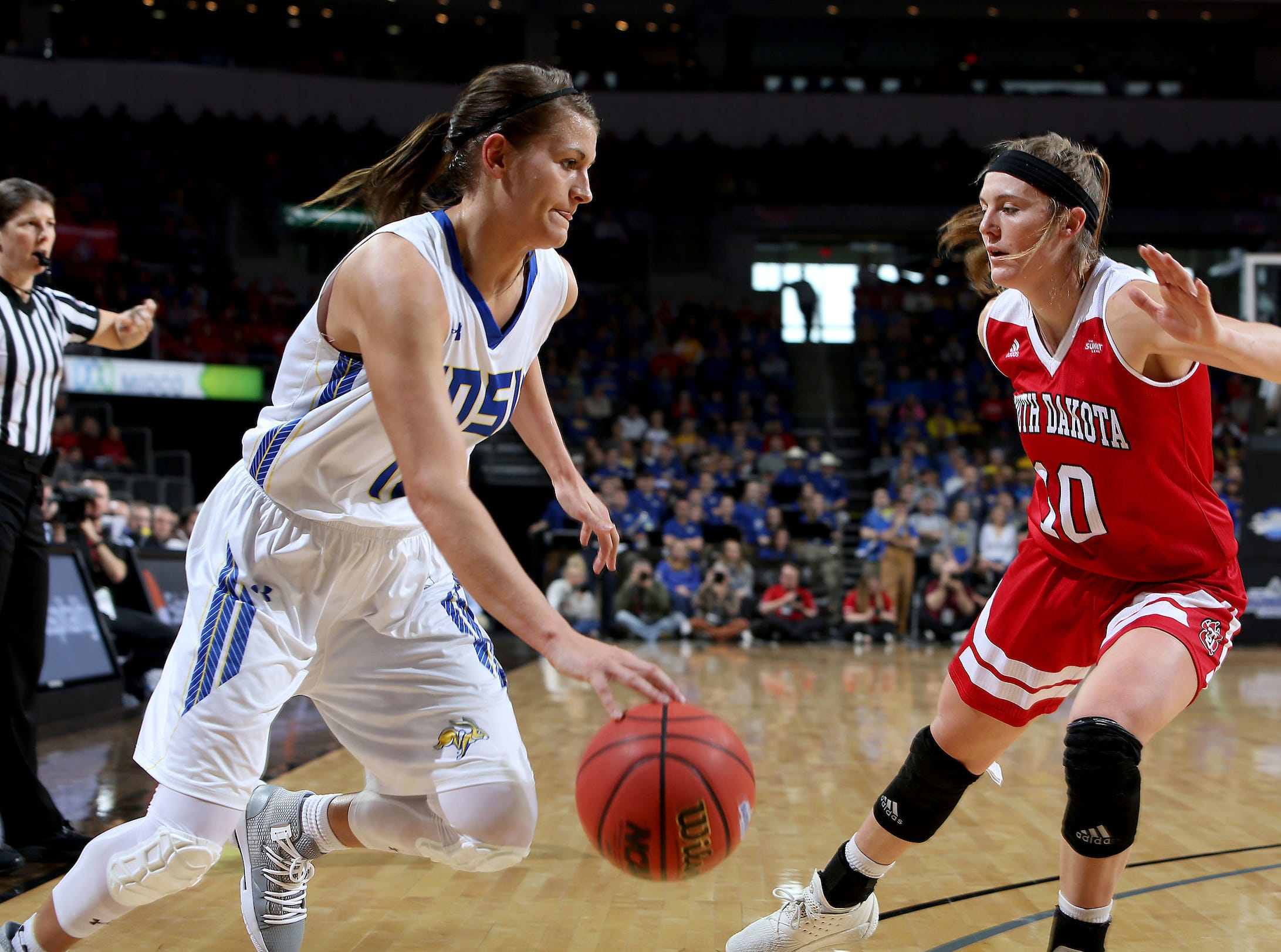 SIOUX FALLS, SD - MARCH 11: Macy Miller #12 from South Dakota State steps around Allison Arens #10 from South Dakota at the 2019 Summit League Basketball Tournament at the Denny Sanford Premier Center in Sioux Falls. (Photo by Dave Eggen/Inertia)