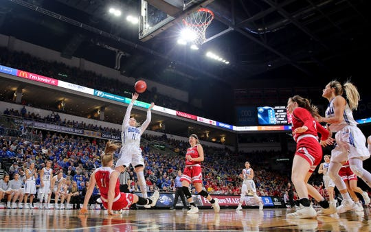 SIOUX FALLS, SD - MARCH 11: Madison Guebert #11 of South Dakota State shoots over a falling Monica Arens #11 of South Dakota at the 2019 Summit League Basketball Tournament at the Denny Sanford Premier Center in Sioux Falls. (Photo by Dave Eggen/Inertia)