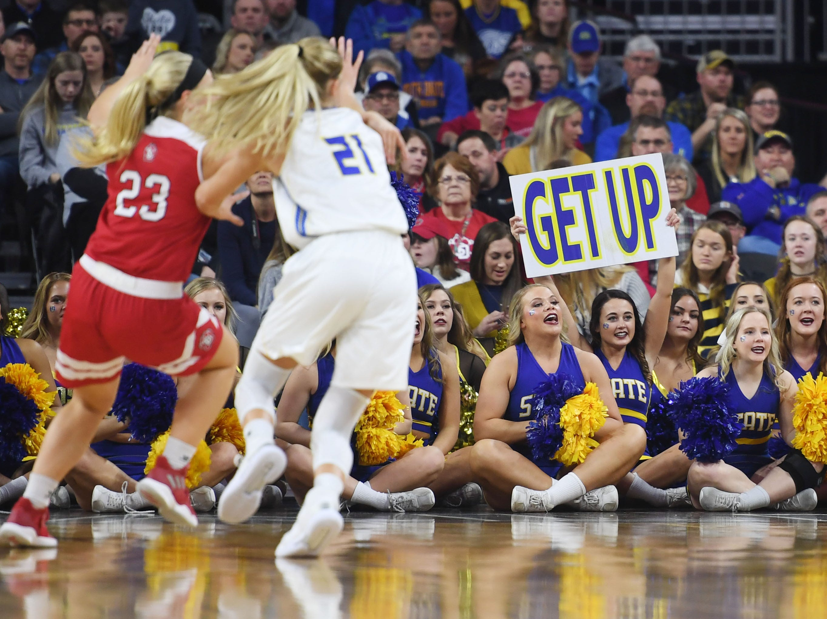 SDSU cheerleaders during the game against USD Tuesday, March 12, in the Summit League women's championship at the Denny Sanford Premier Center in Sioux Falls.