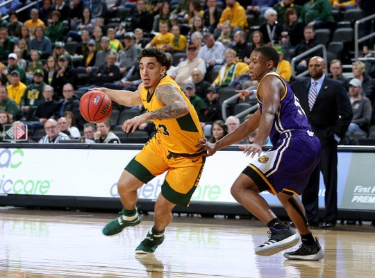 SIOUX FALLS, SD - MARCH 11: Cameron Hunter #22 from North Dakota State dribbles past C.J. Duff #40 from Western Illinois at the 2019 Summit League Basketball Tournament at the Denny Sanford Premier Center in Sioux Falls. (Photo by Dave Eggen/Inertia)