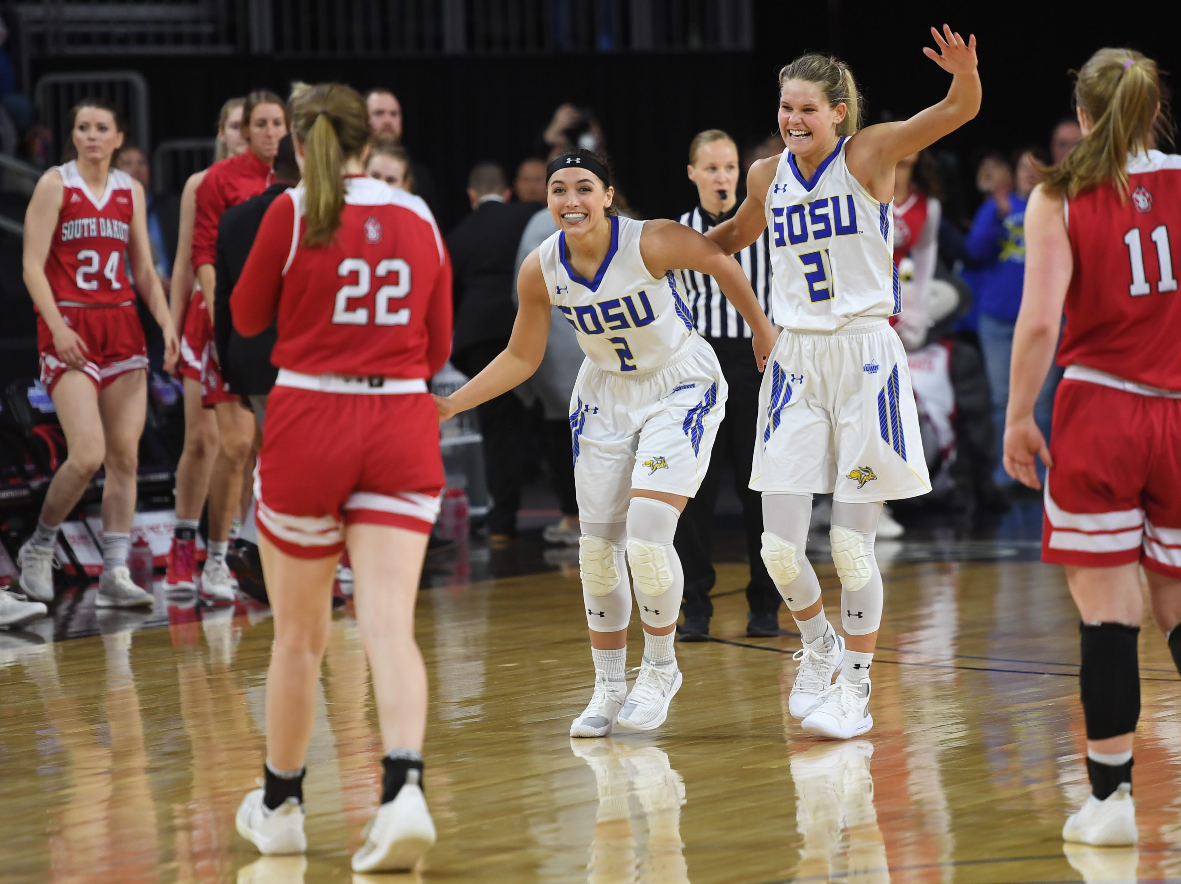 SDSU's Rylie Cascio Jensen (2) and Tylee Irwin (21) begin to celebrate their win against USD Tuesday, March 12, in the Summit League women's championship at the Denny Sanford Premier Center in Sioux Falls.