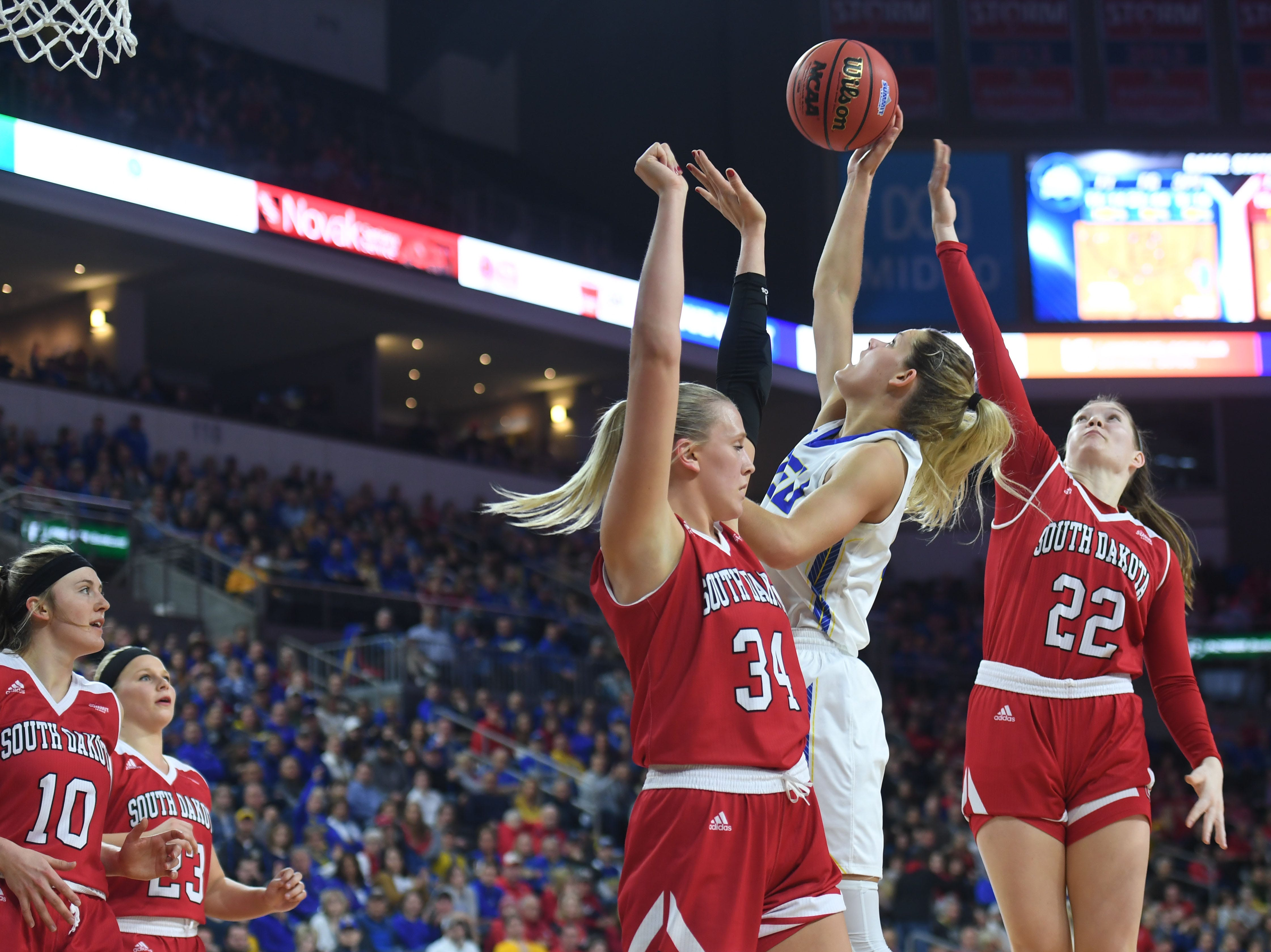 SDSU's Tylee Irwin goes against USD defense under the net during the game Tuesday, March 12, in the Summit League women's championship at the Denny Sanford Premier Center in Sioux Falls.
