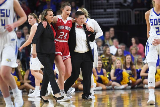 USD's Ciara Duffy is helped off the court after an injury during the game against SDSU Tuesday, March 12, in the Summit League women's championship at the Denny Sanford Premier Center in Sioux Falls.