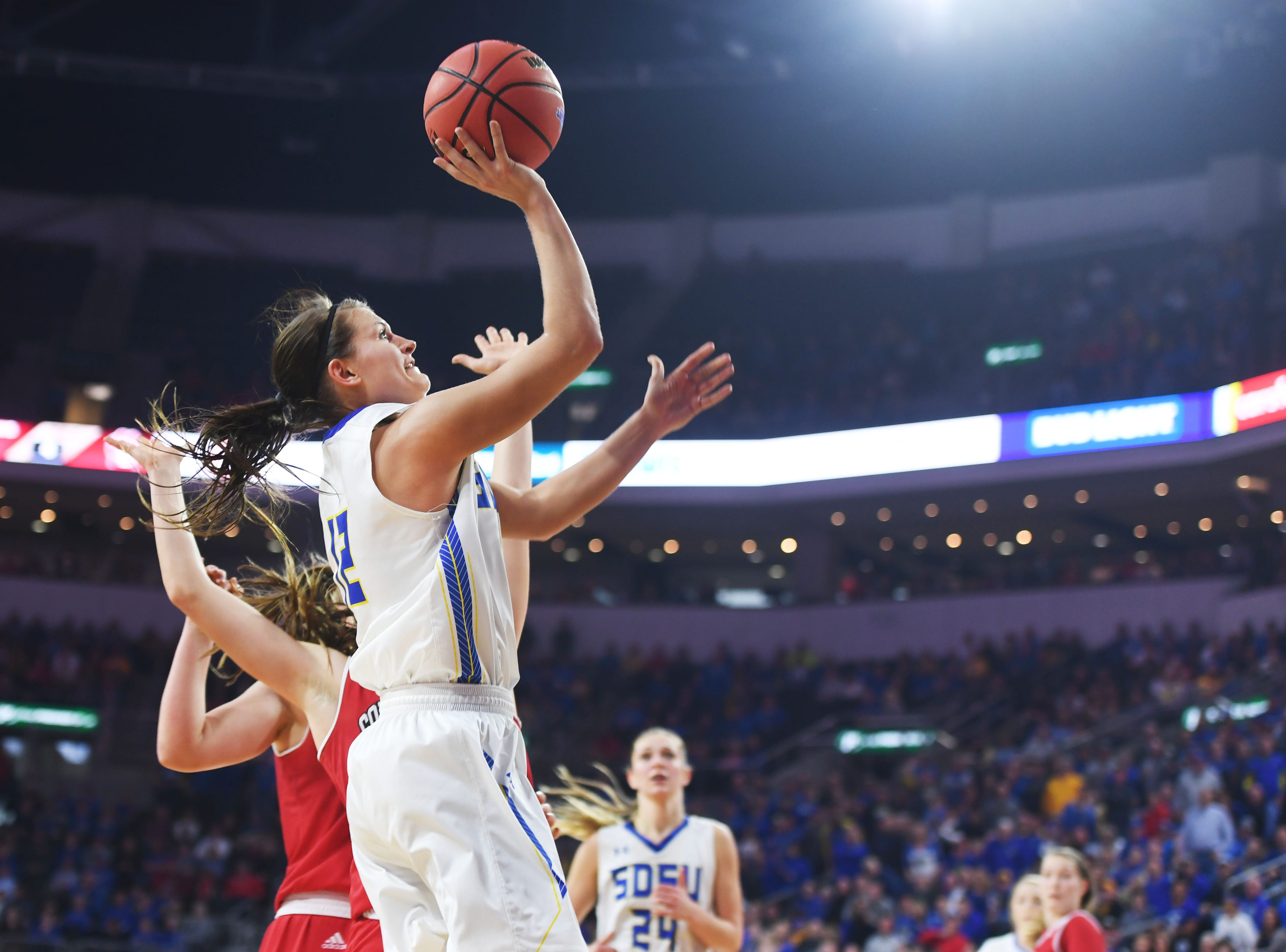 SDSU's Macy Miller scores a basket that makes her the Summit League's all-time leading scorer during the game against USD Tuesday, March 12, in the Summit League women's championship at the Denny Sanford Premier Center in Sioux Falls.