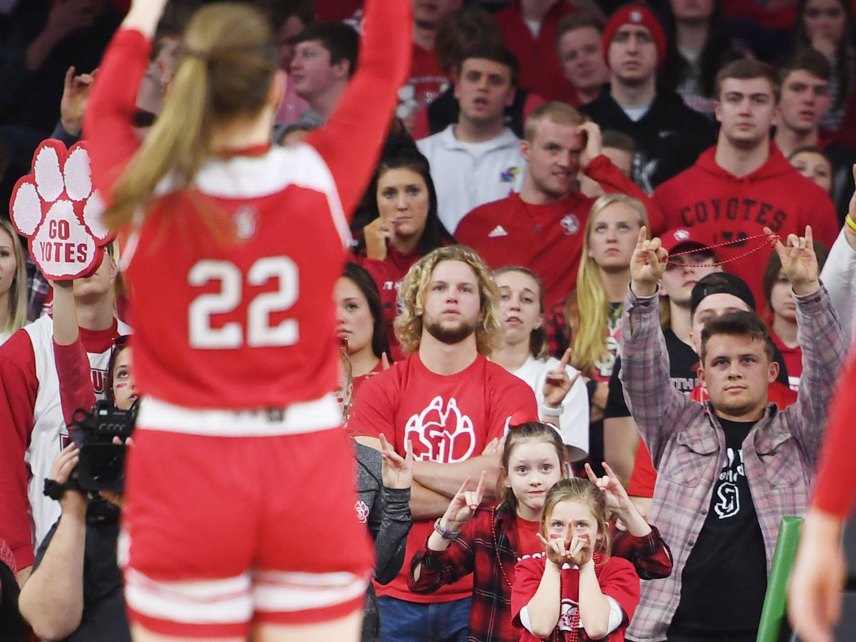 USD fans put their hands up when Chloe Lamb shoots a free throw during the game against SDSU Tuesday, March 12, in the Summit League women's championship at the Denny Sanford Premier Center in Sioux Falls.