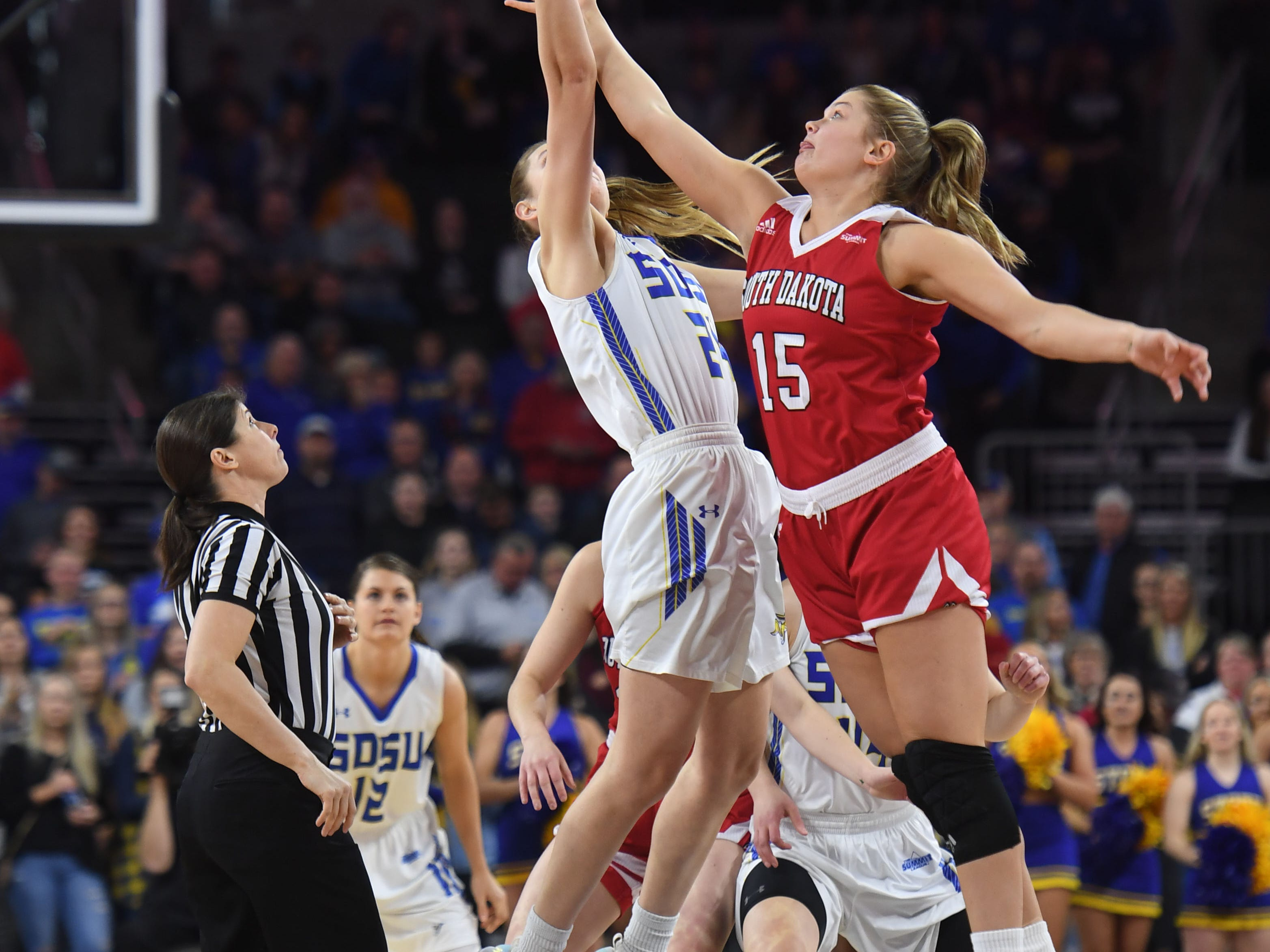 SDSU's Tagyn Larson and USD's Taylor Frederick tip off Tuesday, March 12, in the Summit League women's championship at the Denny Sanford Premier Center in Sioux Falls.