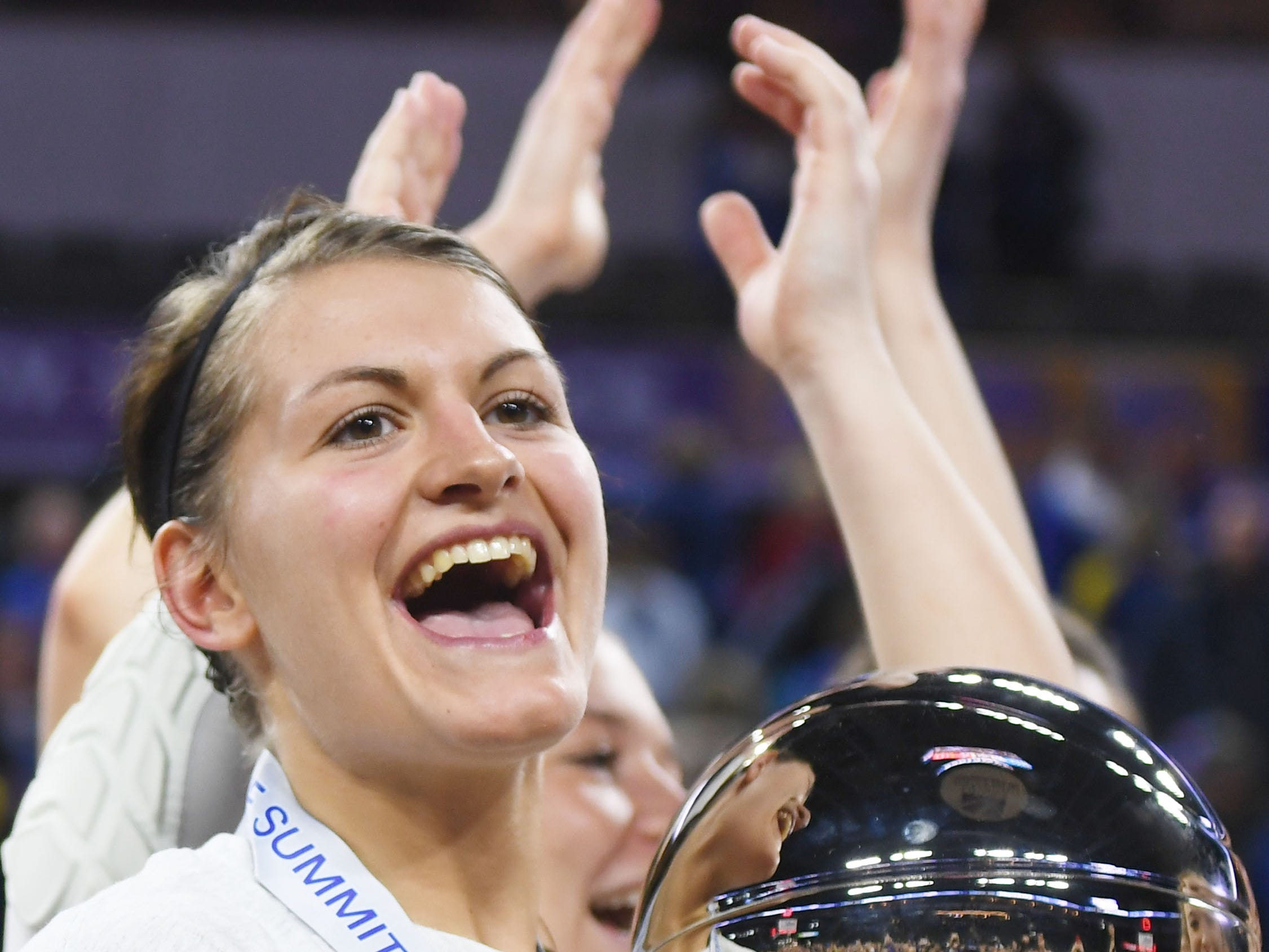 SDSU's Macy Miller holds the trophy after their win against USD Tuesday, March 12, in the Summit League women's championship at the Denny Sanford Premier Center in Sioux Falls.