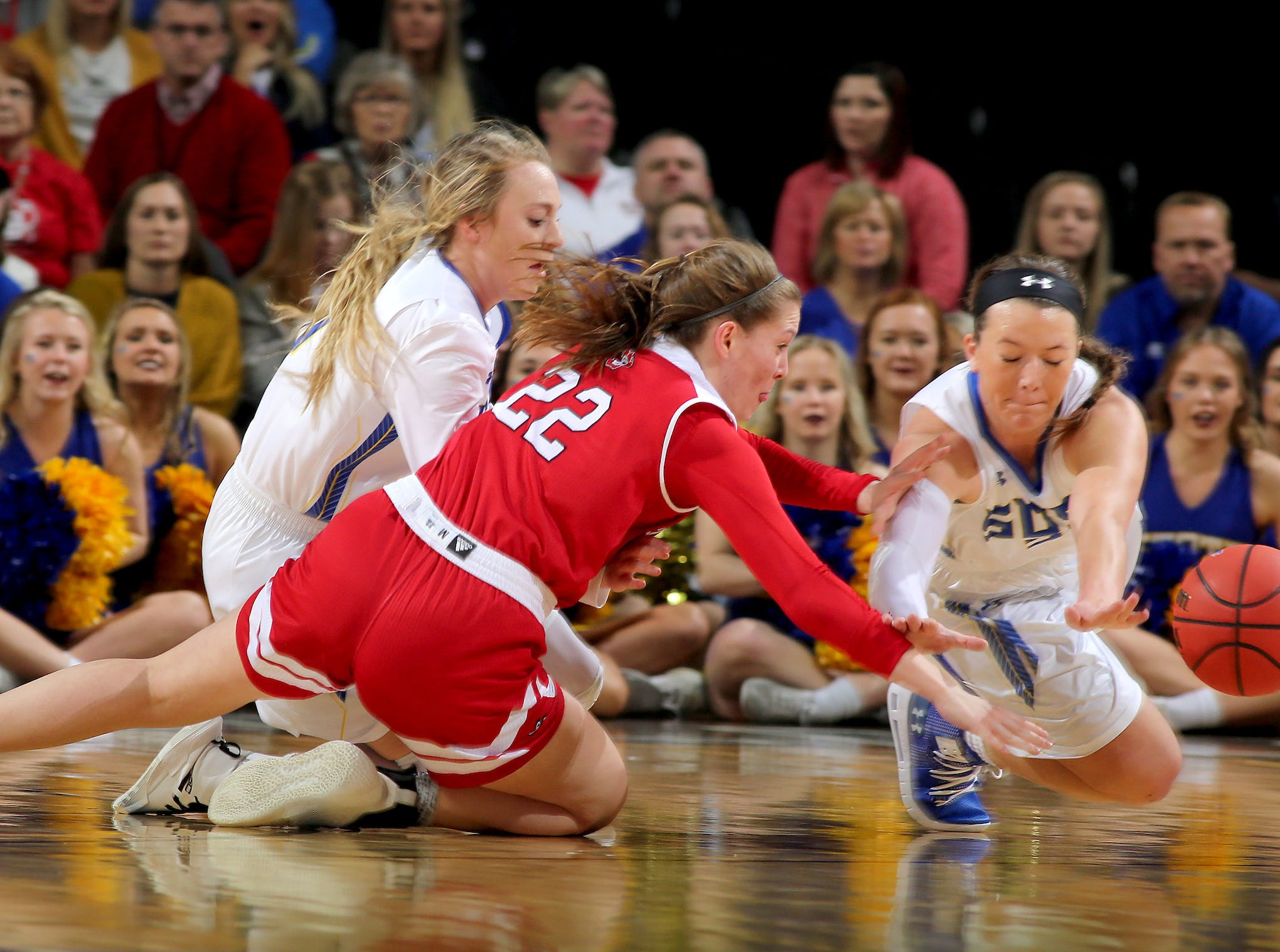 SIOUX FALLS, SD - MARCH 11: Sydney Palmer #32 from South Dakota State and Chloe Lamb #22 from South Dakota dive for a loose ball at the 2019 Summit League Basketball Tournament at the Denny Sanford Premier Center in Sioux Falls. (Photo by Dave Eggen/Inertia)