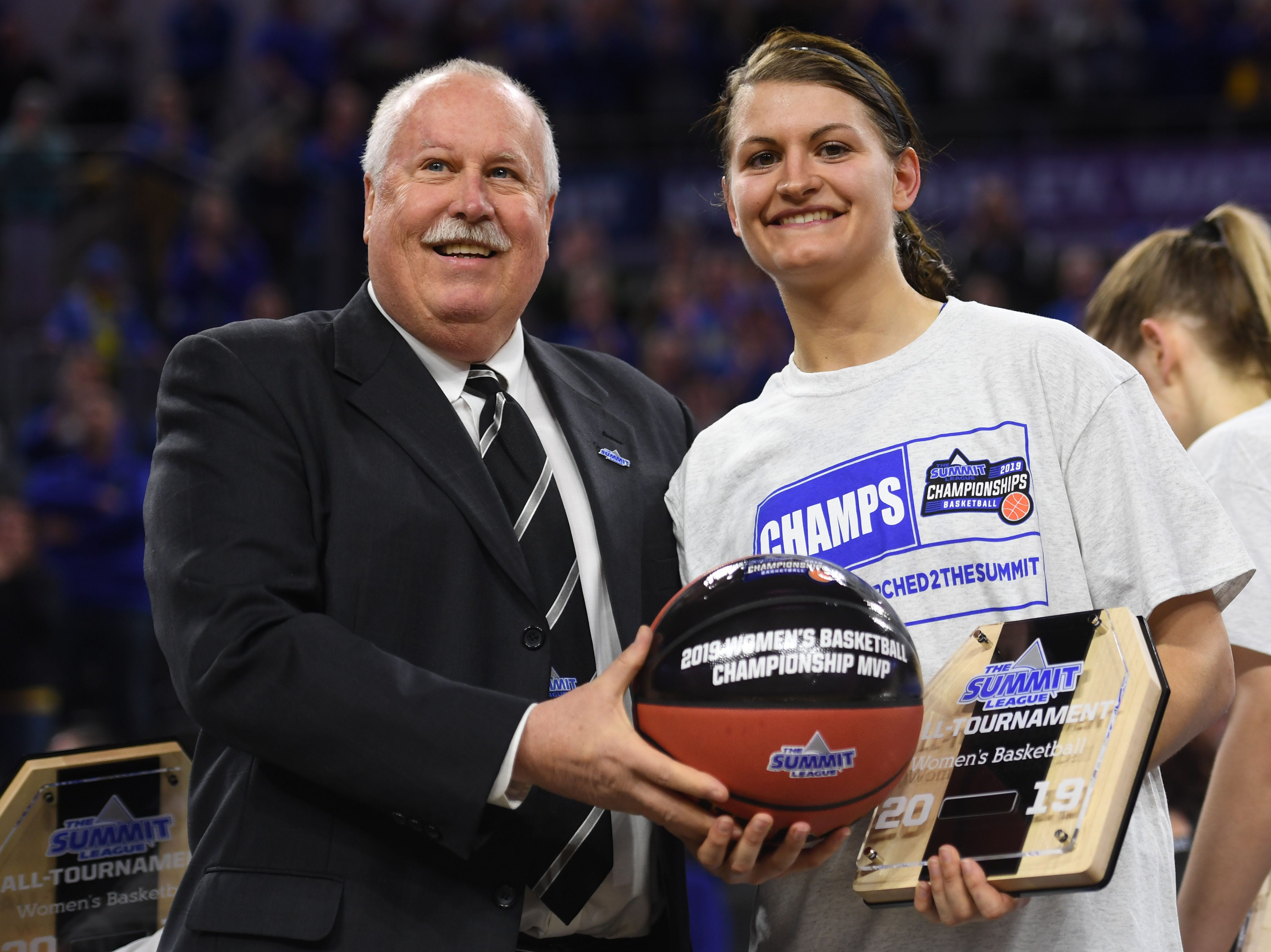 SDSU's Macy Miller receives the 2019 Women's Basketball Championship MVP basketball after the win against USD Tuesday, March 12, in the Summit League women's championship at the Denny Sanford Premier Center in Sioux Falls.