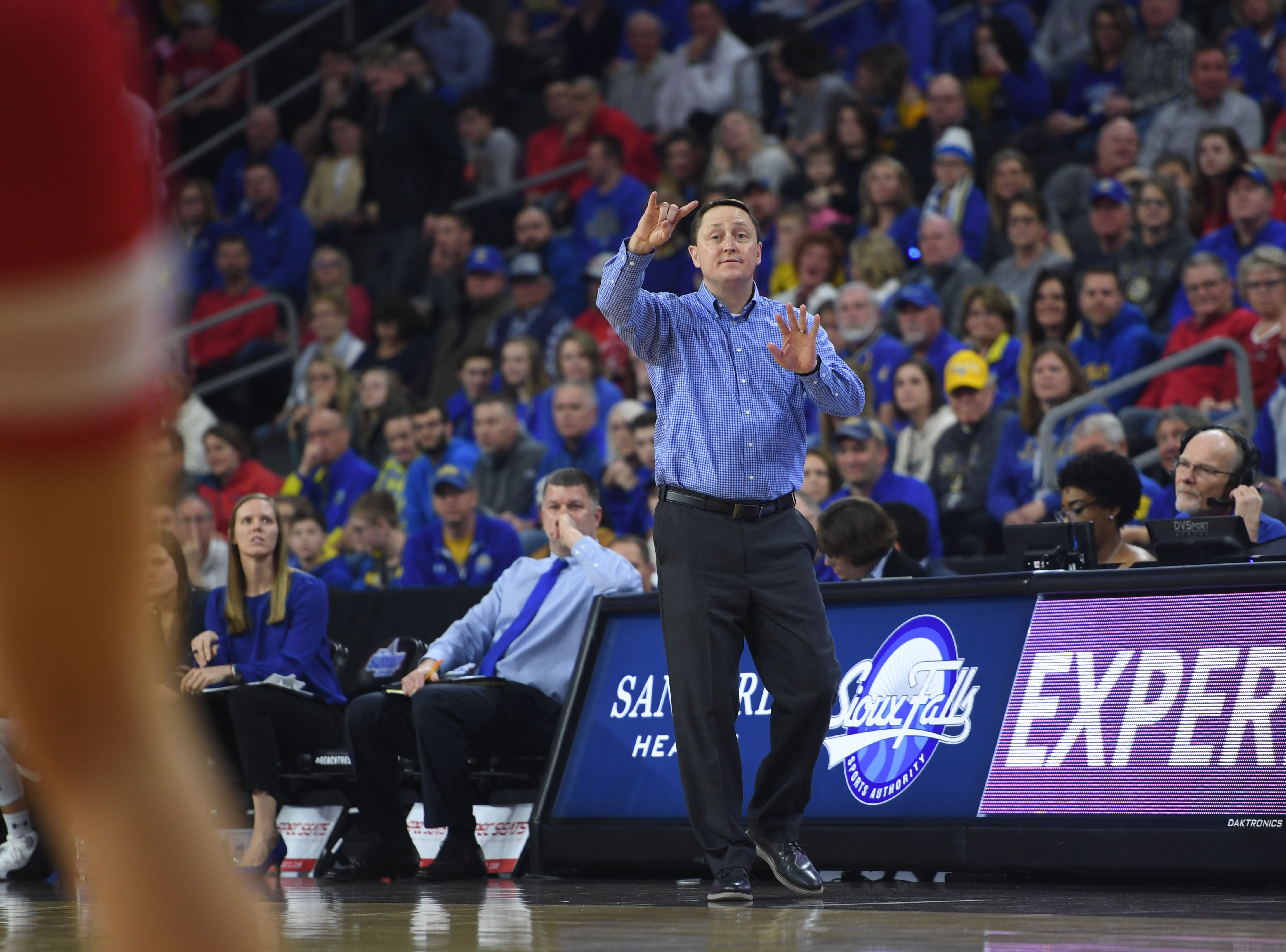 SDSU head coach Aaron Johnston talks to the team during the game against USD Tuesday, March 12, in the Summit League women's championship at the Denny Sanford Premier Center in Sioux Falls.