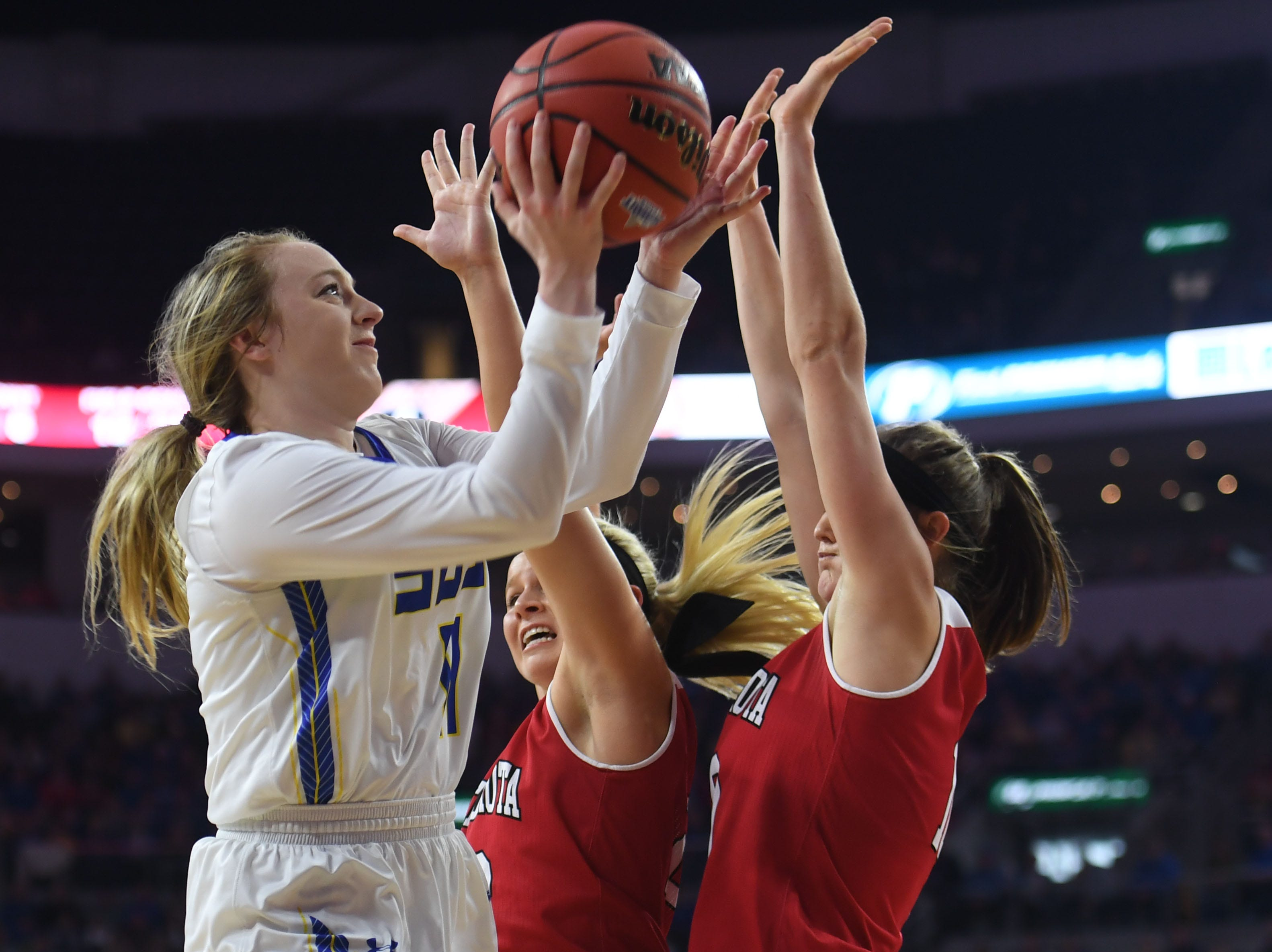 SDSU's Madison Guebert takes a shot against USD defense during the game Tuesday, March 12, in the Summit League women's championship at the Denny Sanford Premier Center in Sioux Falls.
