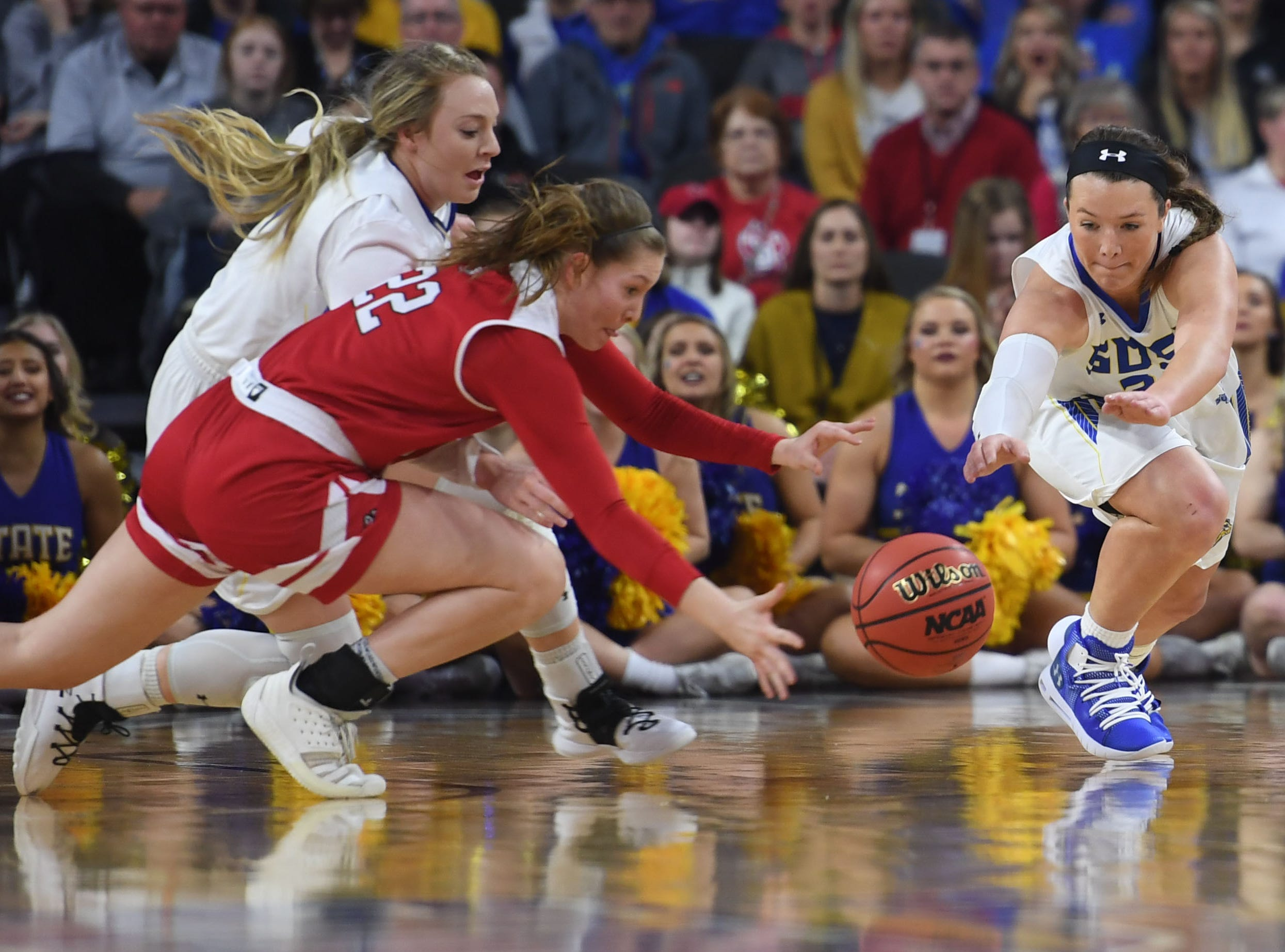 SDSU's Sydney Palmer and USD's Chloe Lamb attempt to gain control of the ball during the game Tuesday, March 12, in the Summit League women's championship at the Denny Sanford Premier Center in Sioux Falls.