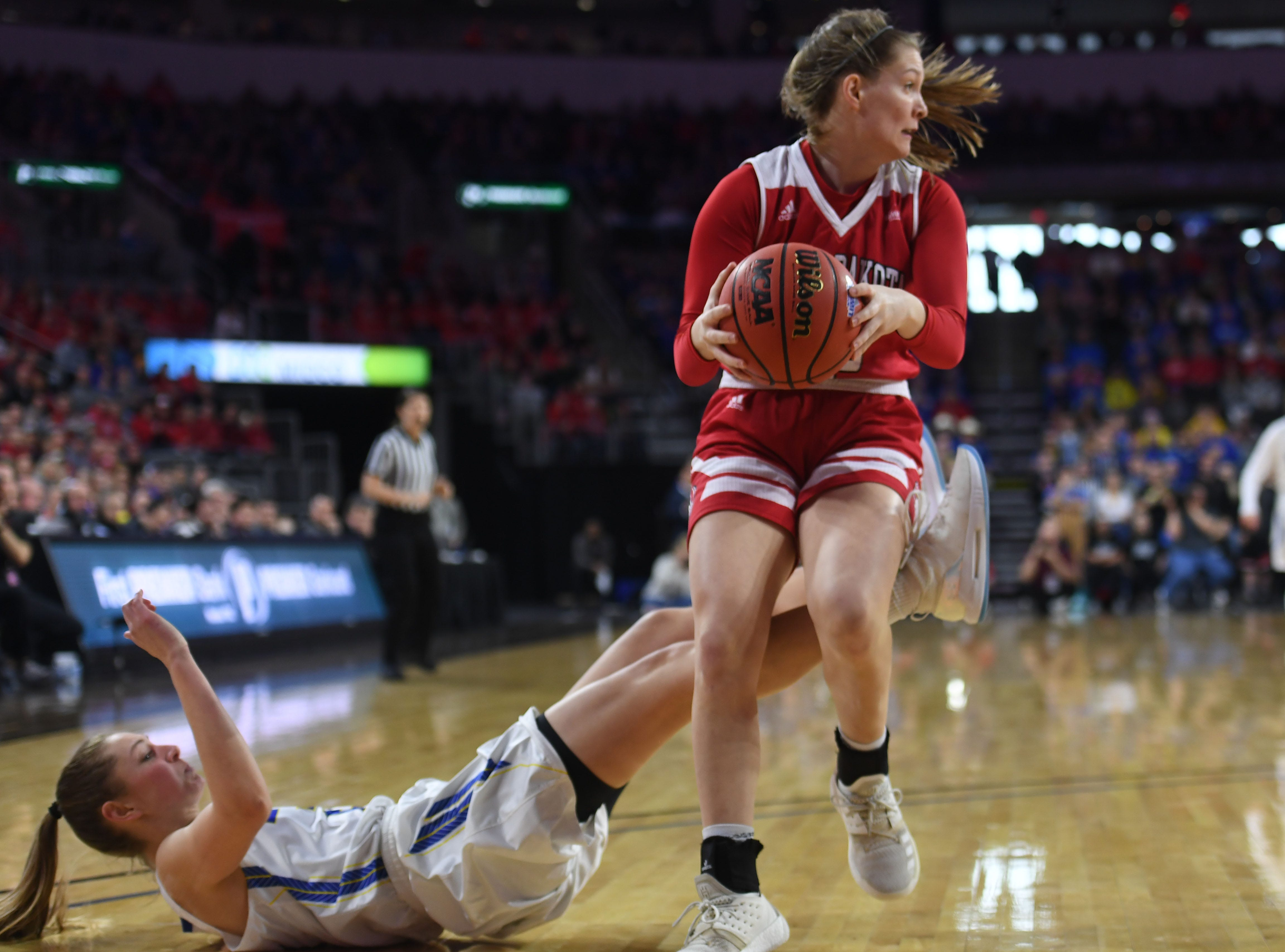 USD's Chloe Lamb goes against SDSU defense during the game Tuesday, March 12, in the Summit League women's championship at the Denny Sanford Premier Center in Sioux Falls.