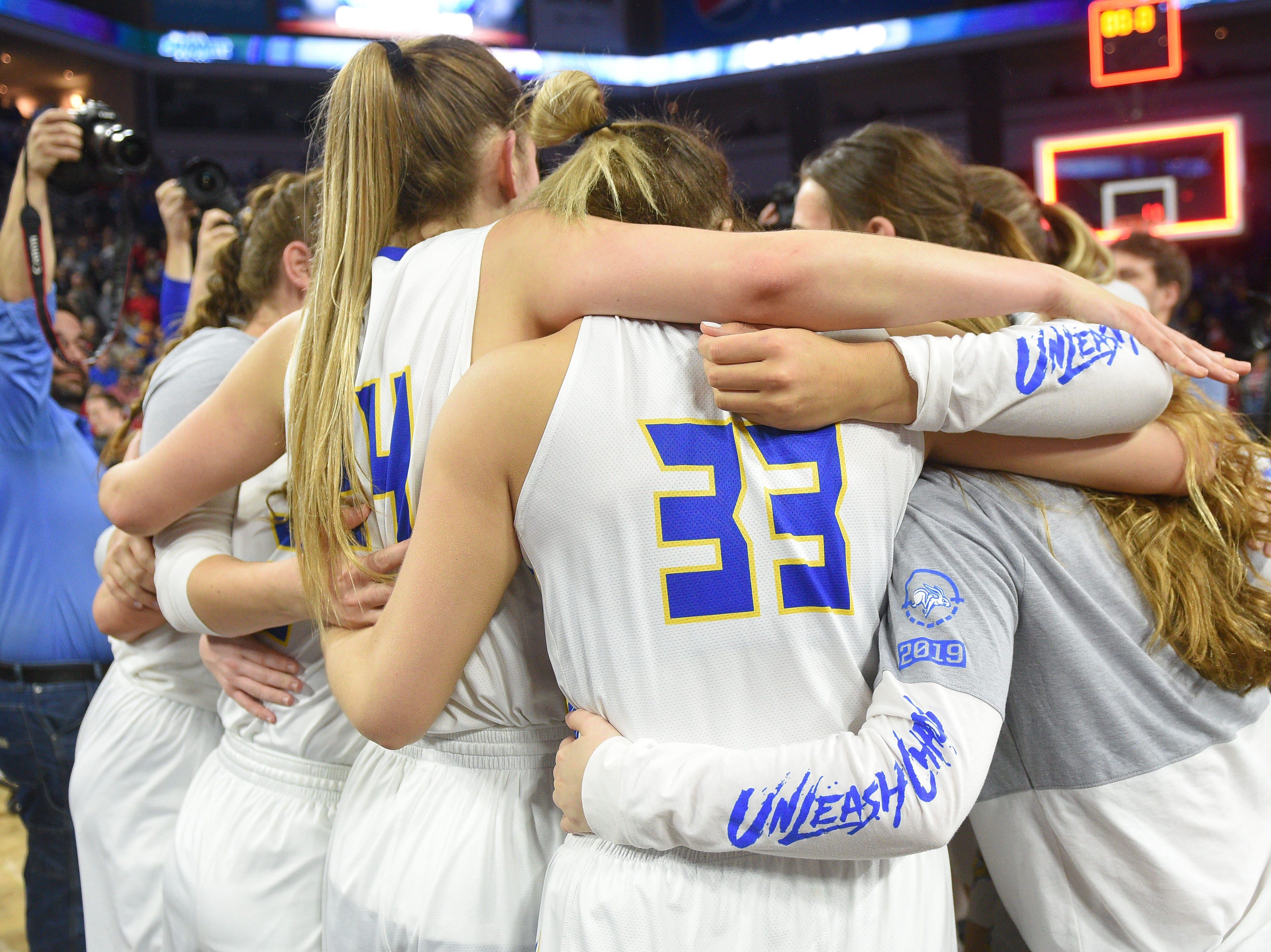 SDSU celebrates their win against USD Tuesday, March 12, in the Summit League women's championship at the Denny Sanford Premier Center in Sioux Falls.