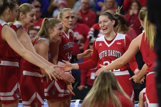 USD's Chloe Lamb runs onto the court for the game against SDSU Tuesday, March 12, in the Summit League women's championship at the Denny Sanford Premier Center in Sioux Falls.