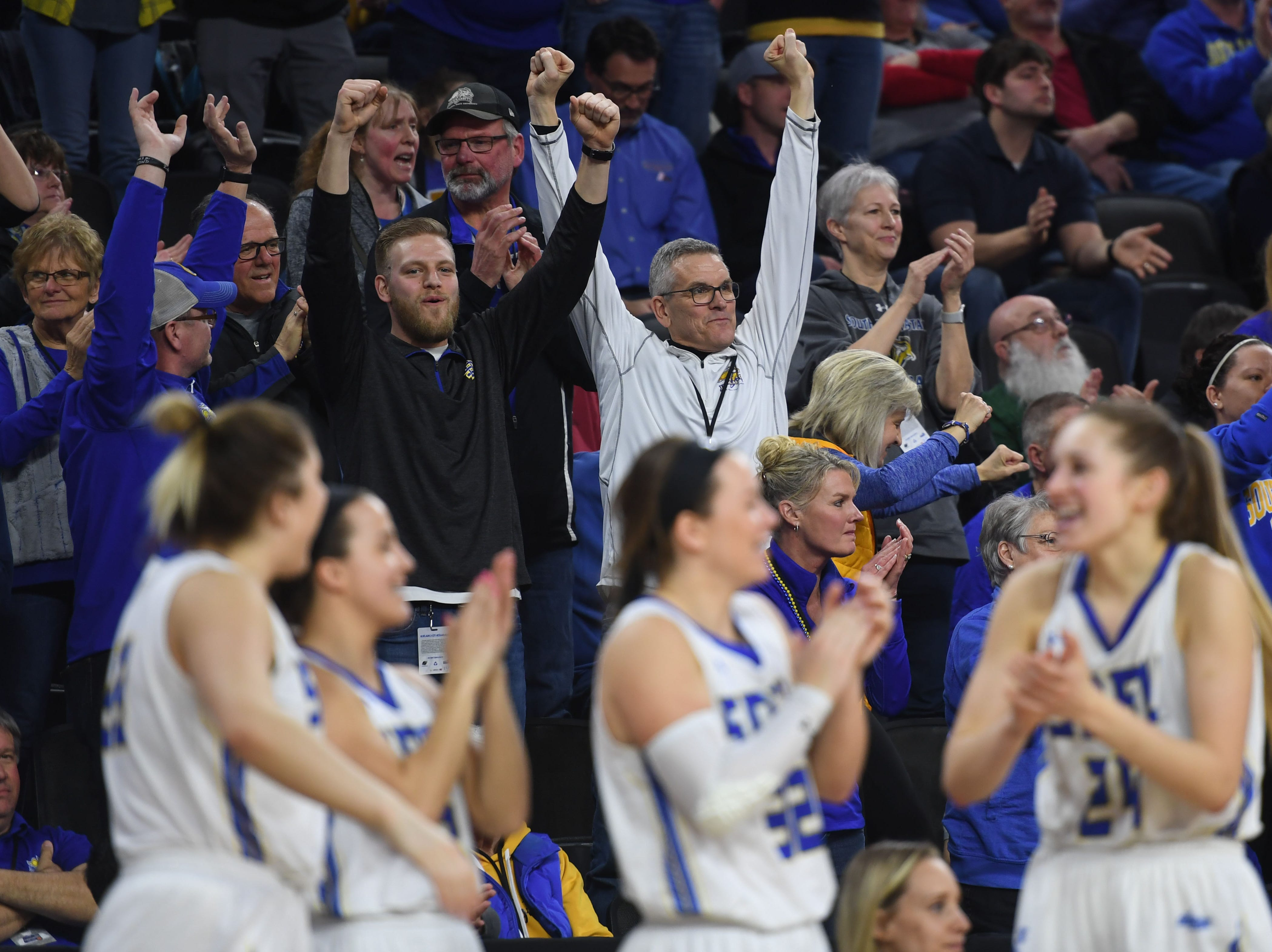 SDSU fans begin to cheer in the final seconds of the game against USD Tuesday, March 12, in the Summit League women's championship at the Denny Sanford Premier Center in Sioux Falls.