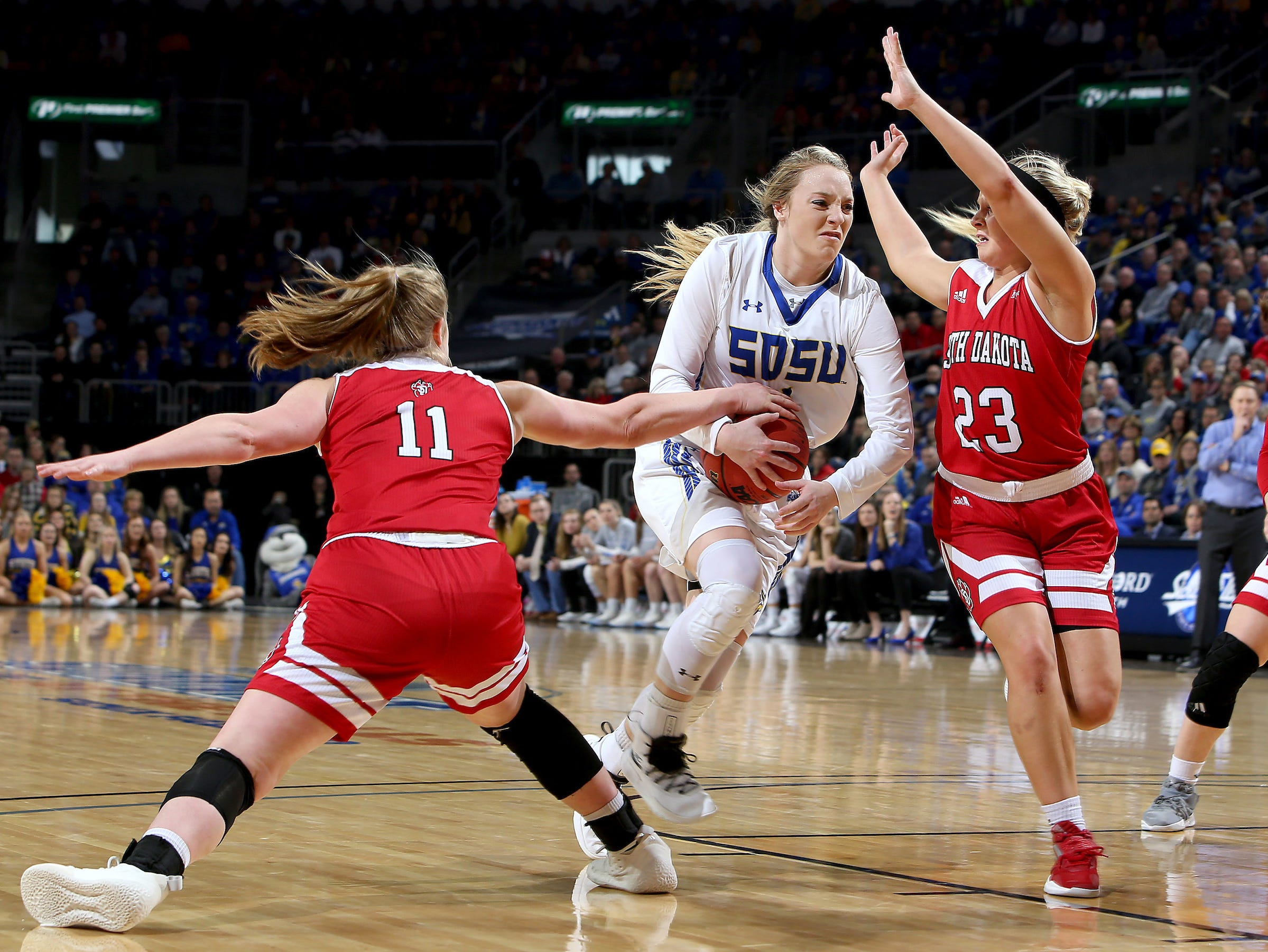 SIOUX FALLS, SD - MARCH 11: Monica Arens #11 from South Dakota gets a hand on the ball possessed by Madison Guebert #11 from South Dakota State at the 2019 Summit League Basketball Tournament at the Denny Sanford Premier Center in Sioux Falls. (Photo by Dave Eggen/Inertia)