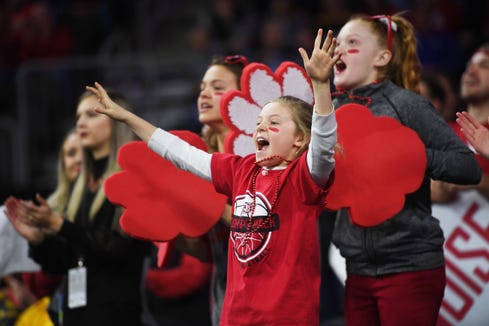 USD fans cheer during the game against SDSU Tuesday, March 12, in the Summit League women's championship at the Denny Sanford Premier Center in Sioux Falls.