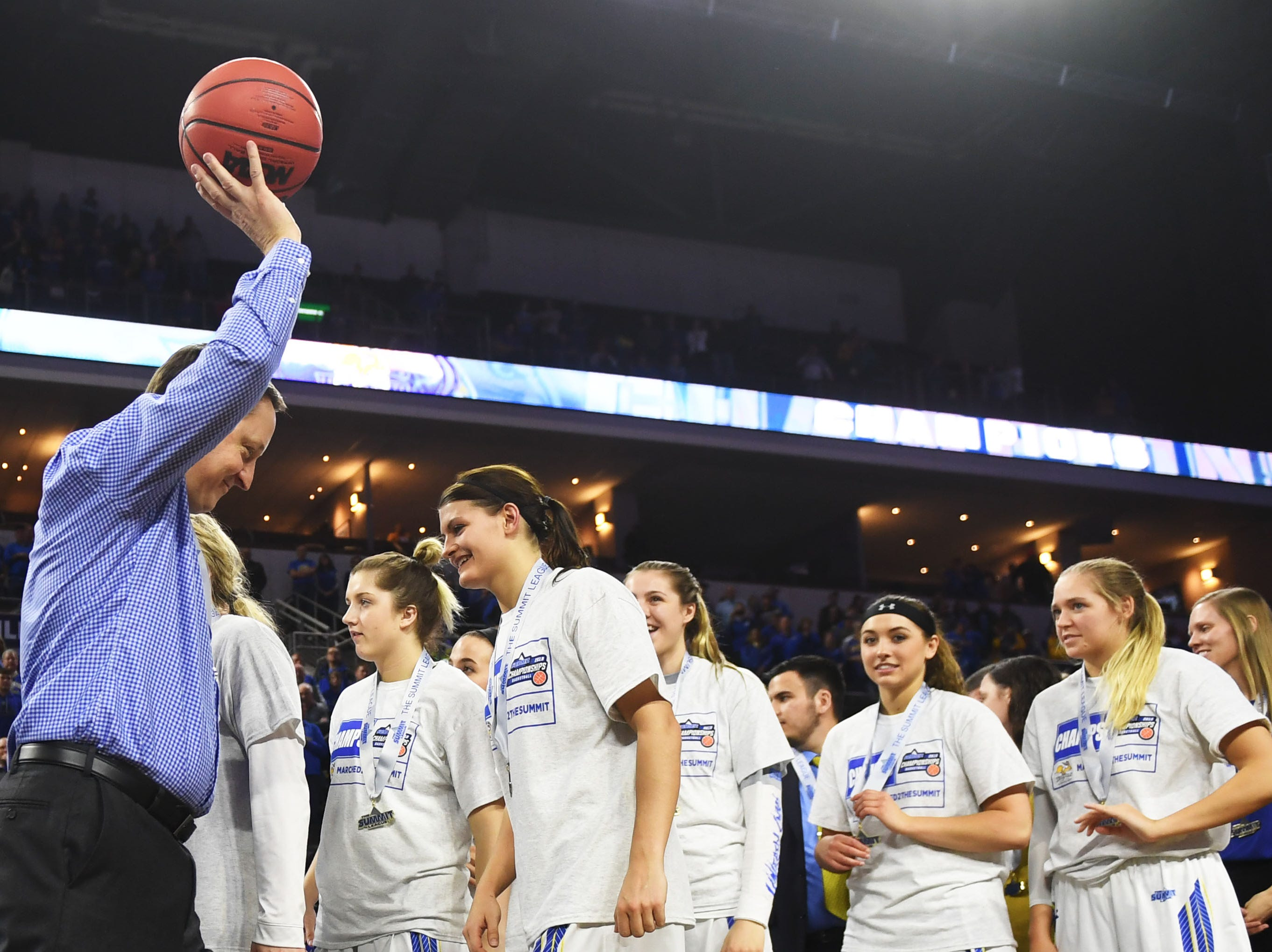 SDSU's head coach Aaron Johnston is recognized after the win against USD Tuesday, March 12, in the Summit League women's championship at the Denny Sanford Premier Center in Sioux Falls.