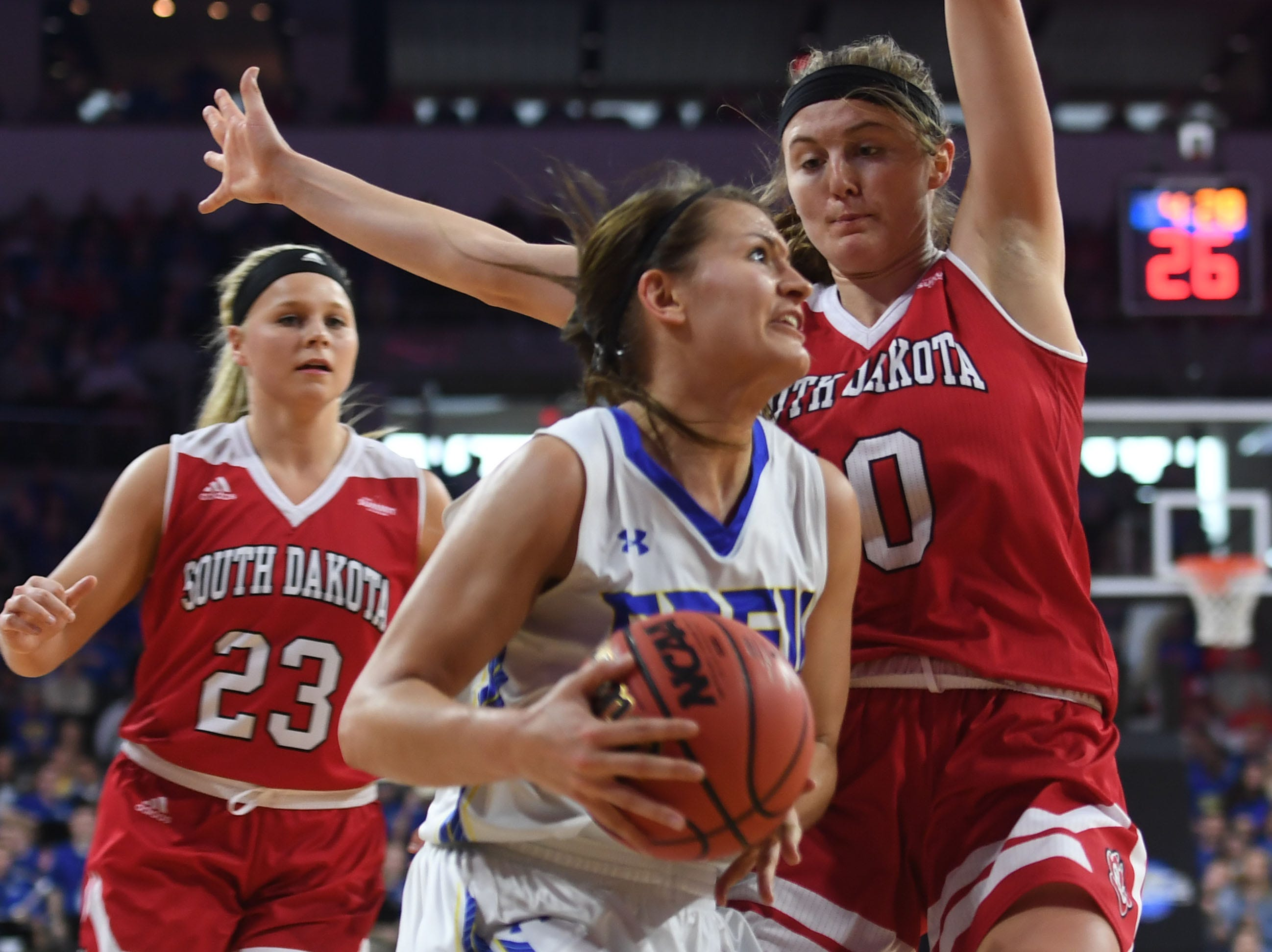 SDSU's Macy Miller goes against USD's Allison Arens during the game Tuesday, March 12, in the Summit League women's championship at the Denny Sanford Premier Center in Sioux Falls.