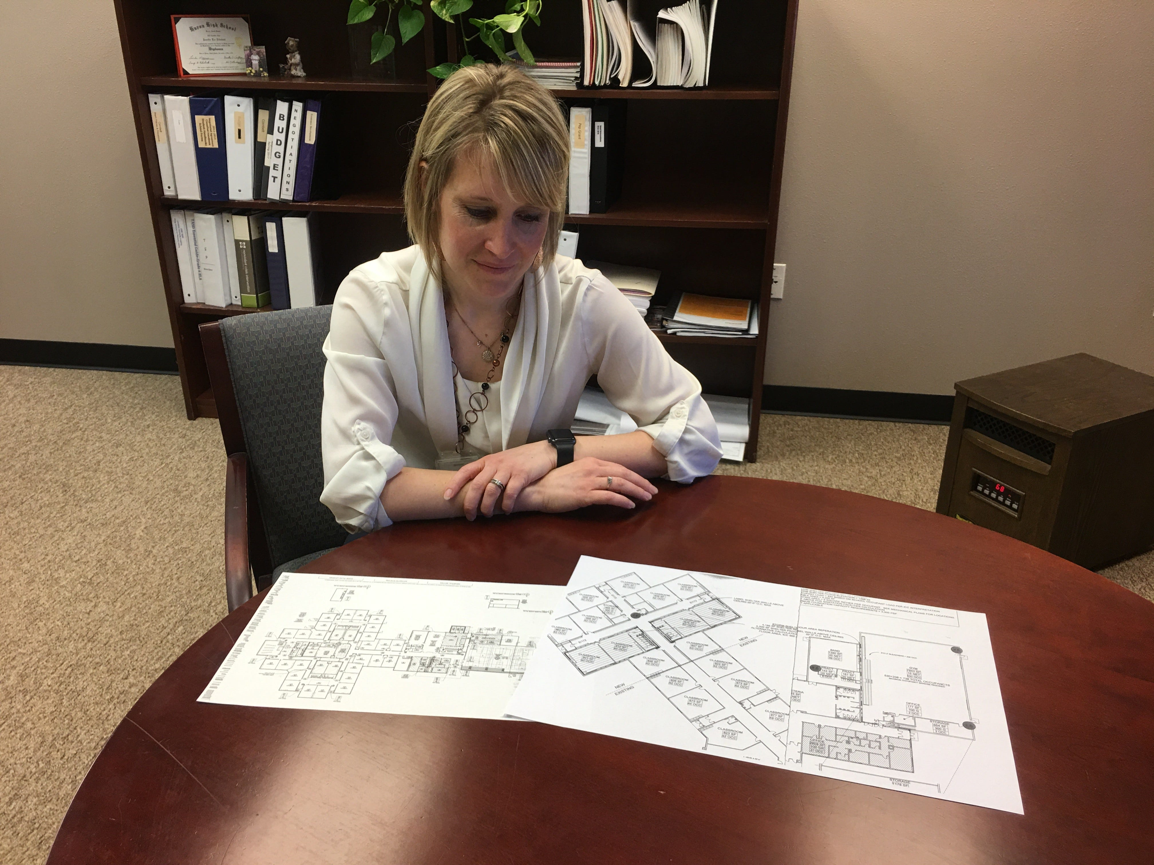 Superintendent Jennifer Lowery  reviews schematics Tuesday to expand Frontier Elementary and complete the new Venture Elementary by fall for Tea Area School District