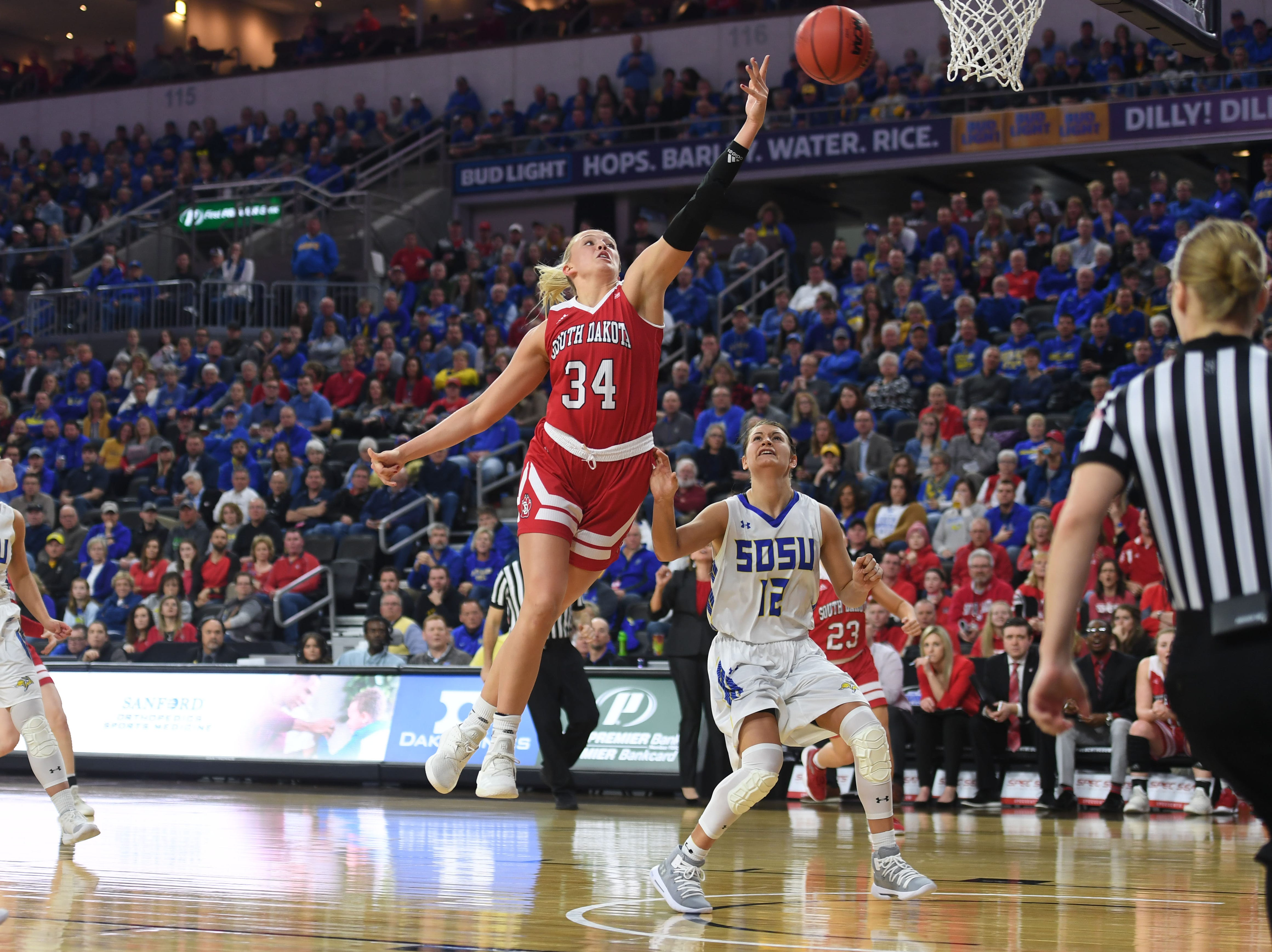 USD's Hannah Sjerven goes against SDSU defense during the game Tuesday, March 12, in the Summit League women's championship at the Denny Sanford Premier Center in Sioux Falls.