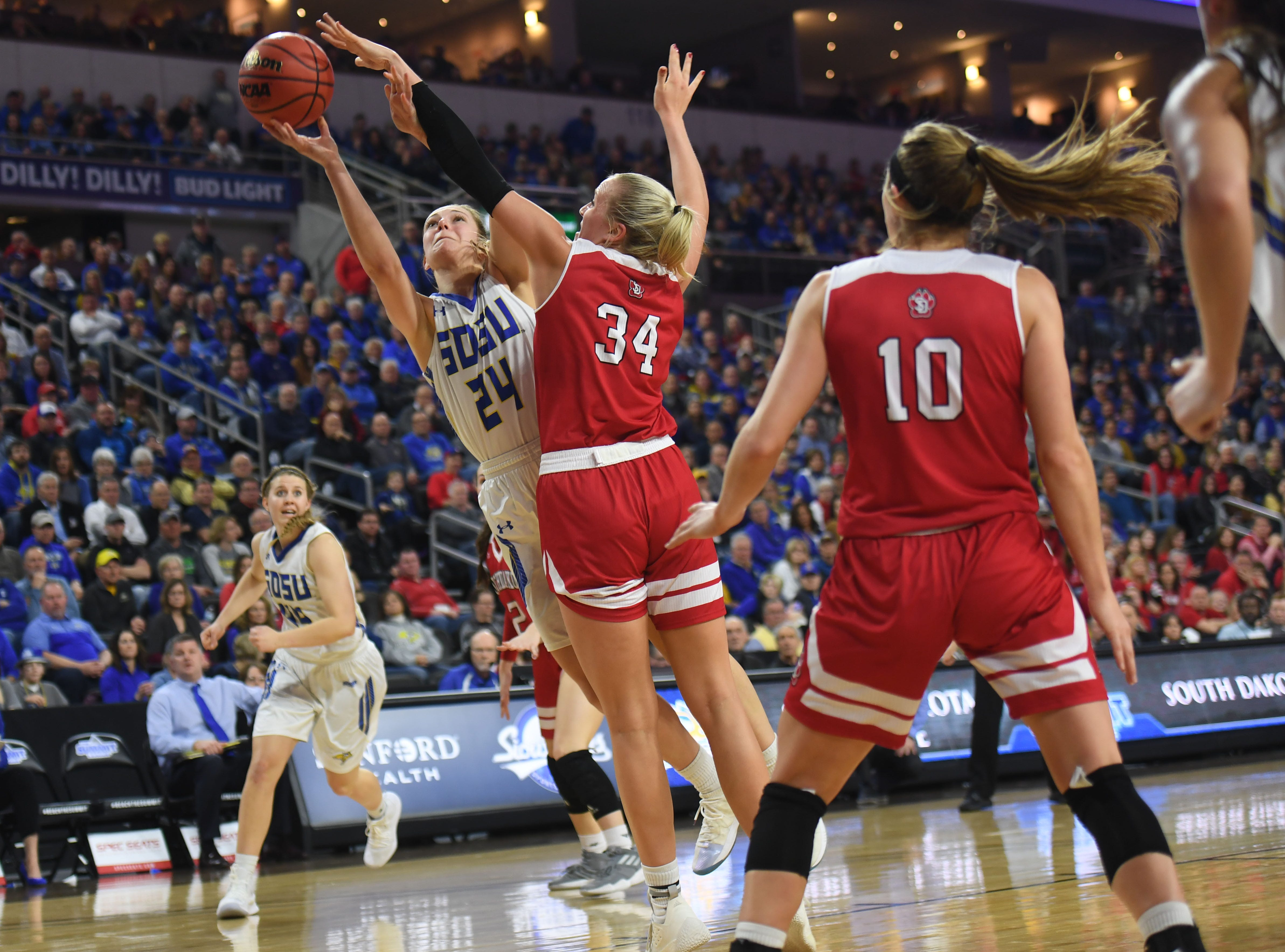 SDSU's Tagyn Larson goes against USD's Hannah Sjerven during the game Tuesday, March 12, in the Summit League women's championship at the Denny Sanford Premier Center in Sioux Falls.