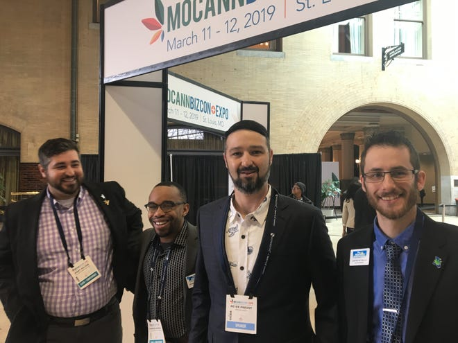 Desmond Morris (center-left) and members of his Wholesome Bud Company team stood for a photo at a medical marijuana trade conference in St. Louis on March 12, 2019. Morris's Springfield-based company is applying to the Missouri health department for medical marijuana business licenses. The application window is Aug. 3 to Aug. 17, 2019.