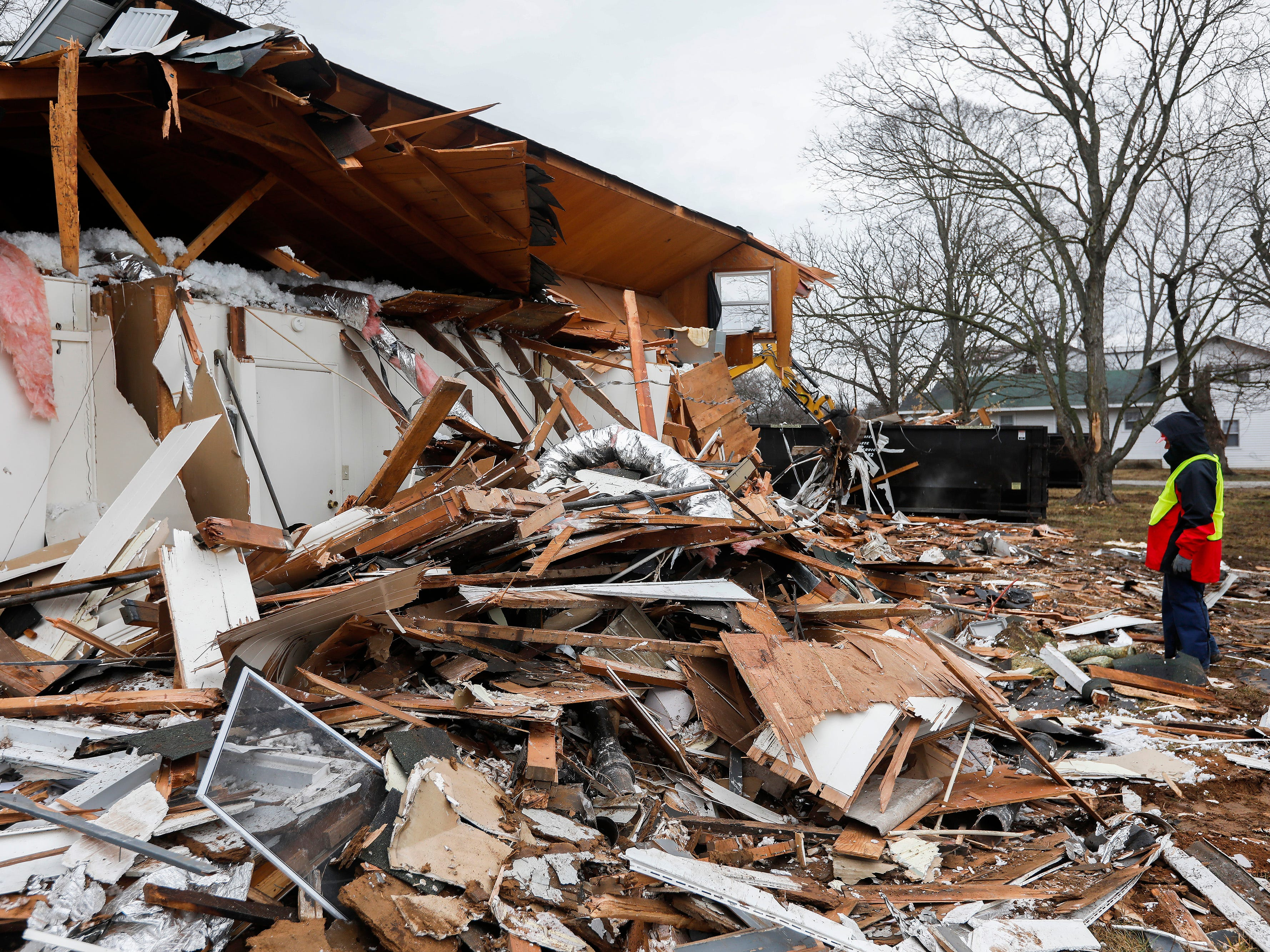 Jim Aubry, a volunteer with Convoy of Hope, watches as a home at the Ozark Mill Finley Farms development is demolished on Tuesday, March 12, 2019. Members of the organization were gaining experience with demolition for when a real disaster strikes.