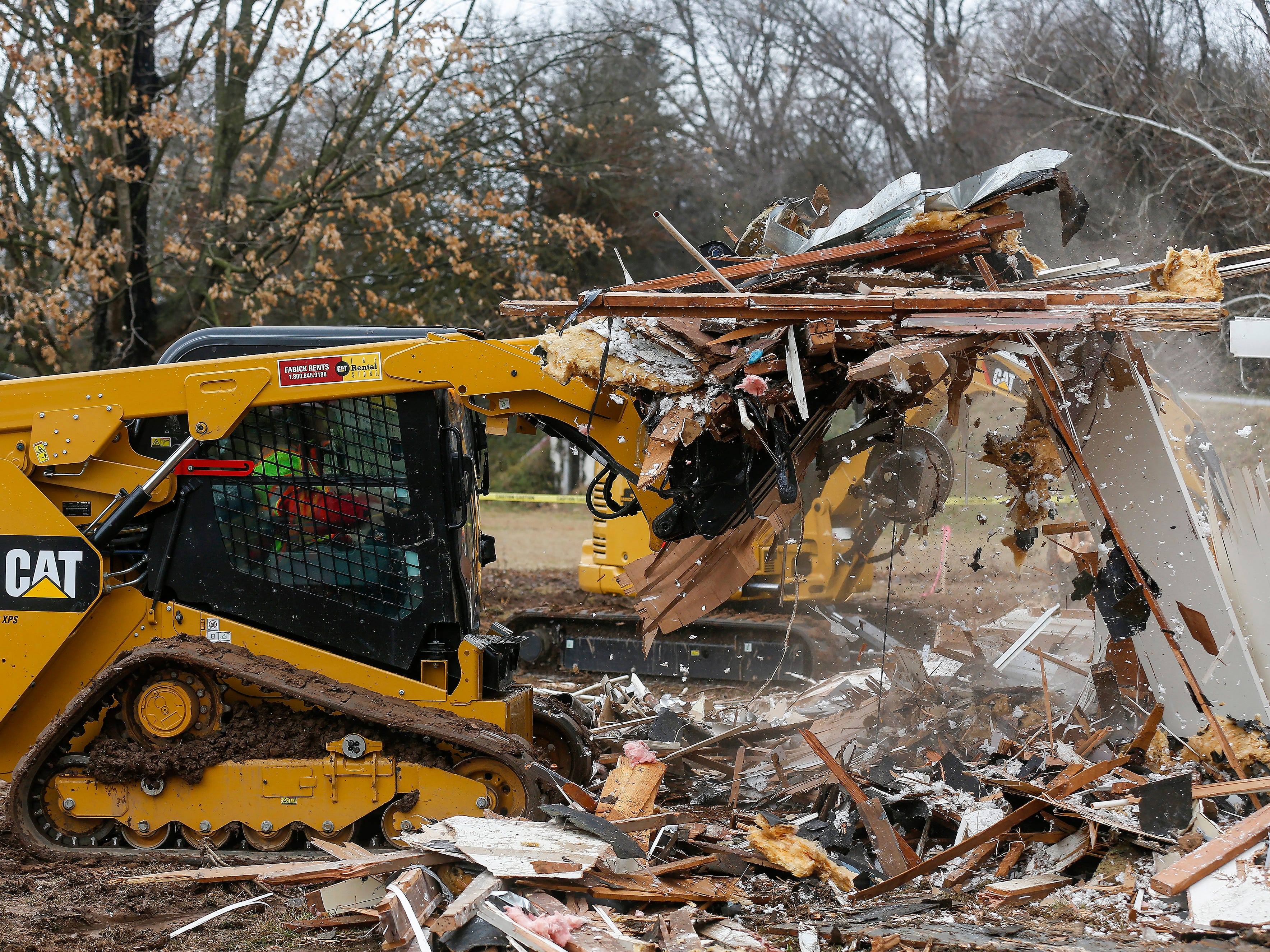 Members of Convoy of Hope demolish a home at the Ozark Mill Finley Farms development on Tuesday, March 12, 2019. Members of the organization were gaining experience with demolition for when a real disaster strikes.