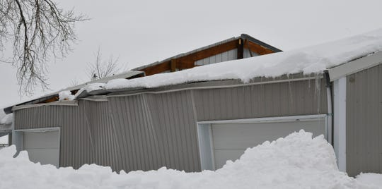 The roof of the Lions building is collapsed and the walls are pushed out in this photograph taken Tuesday, March 12, at the Benton County Fairgrounds in Sauk Rapids.