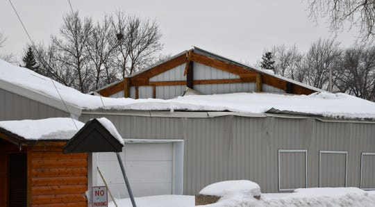 The roof of the Lions building is collapsed Tuesday, March 12, at the Benton County Fairgrounds in Sauk Rapids.
