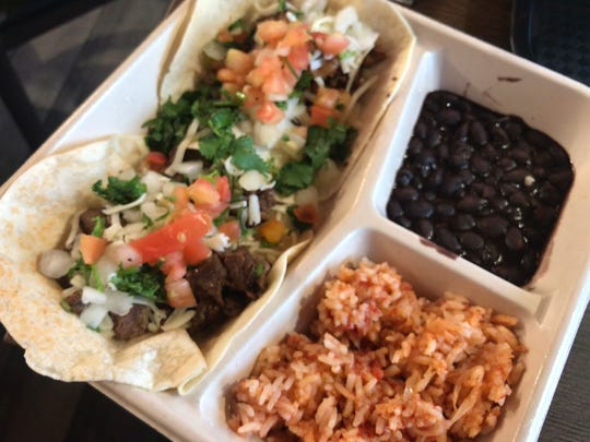 Customers can choose one or two types of meats on the taco plate at Chronic Tacos.
